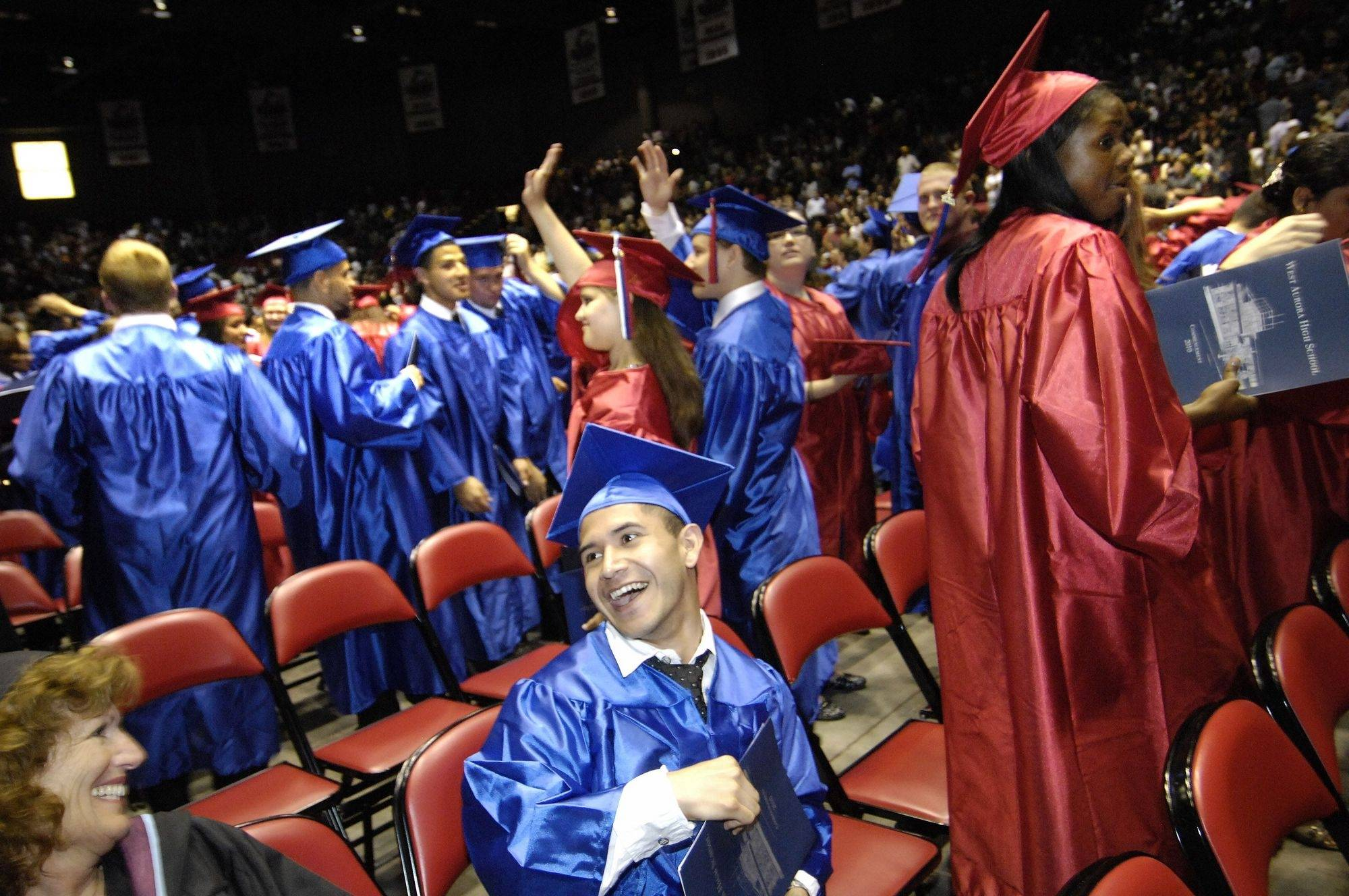 Jorge Garcia laughs with classmates during commencement exercises for West Aurora High School on Monday night at the Convocation Center in Dekalb.