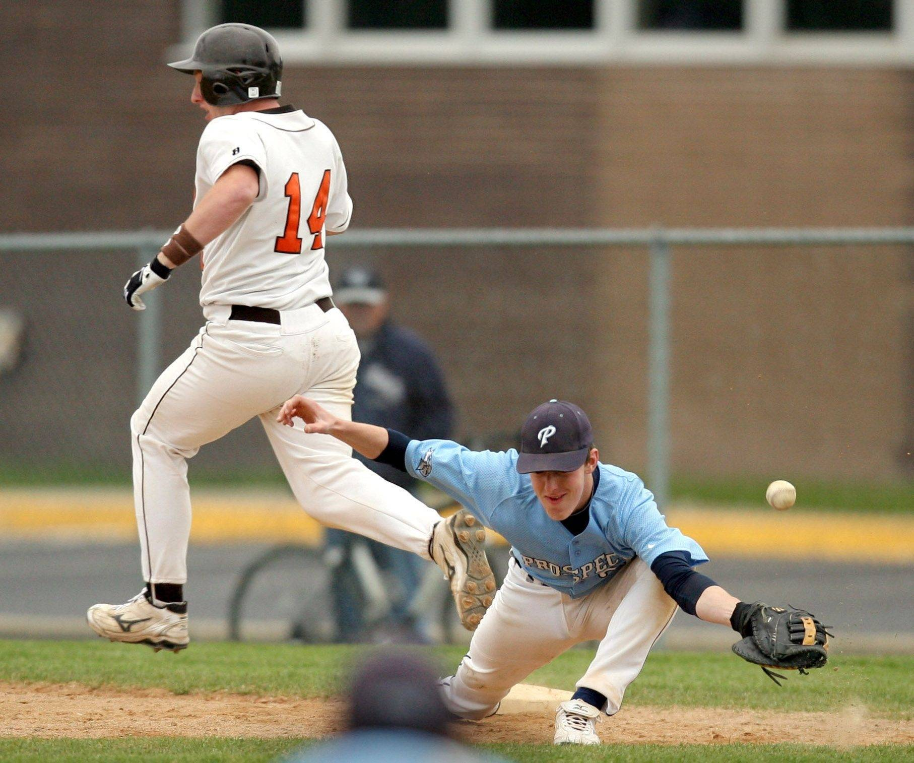 Hersey's Sean Thompson, left, is safe at first as Prospect's Brian Bauer tries to control an errant throw during their game at Hersey High School Monday.
