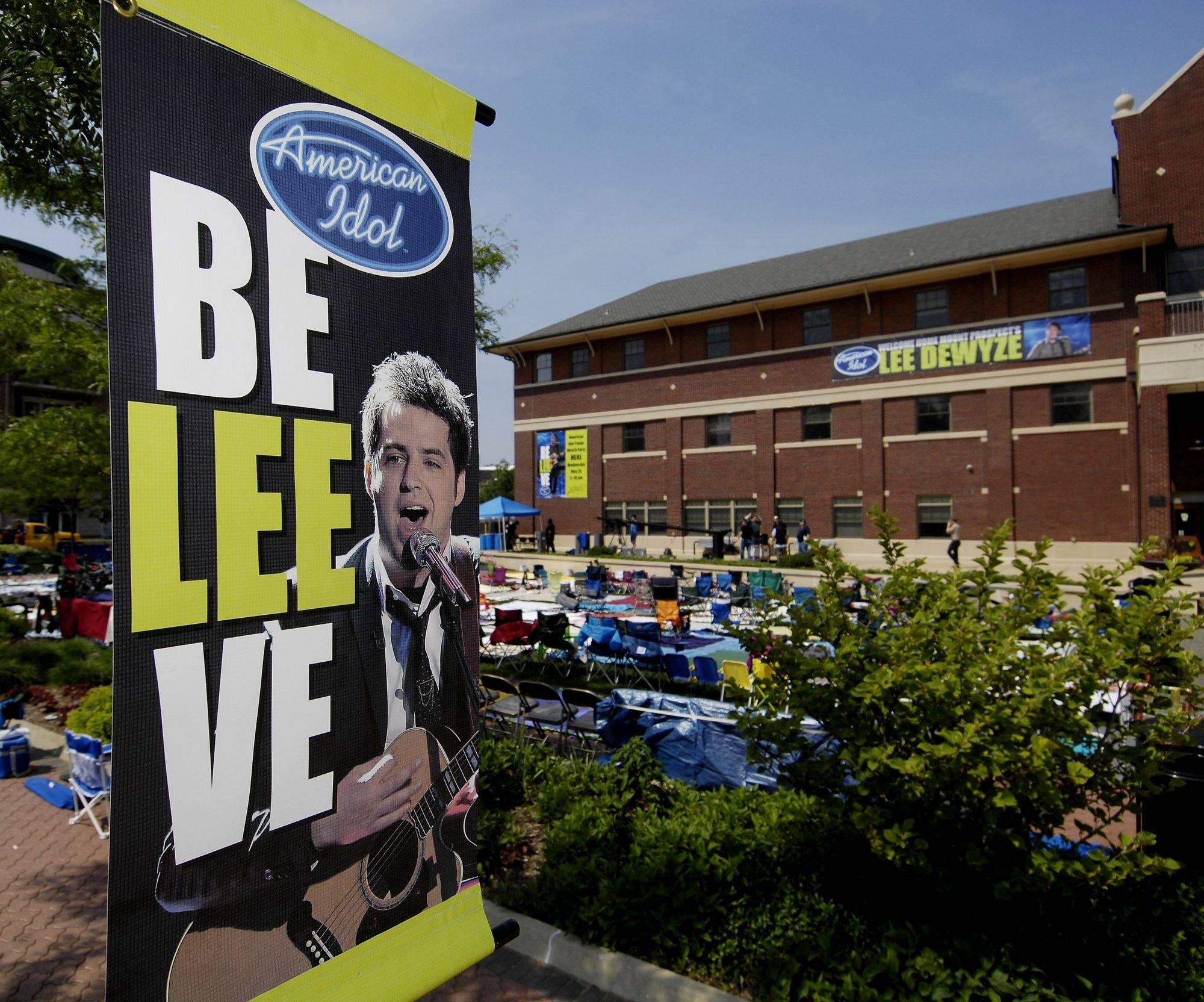 "A street light banner in support of Lee DeWyze hangs next to the area set up for Wednesday night's ""American Idol"" viewing party."