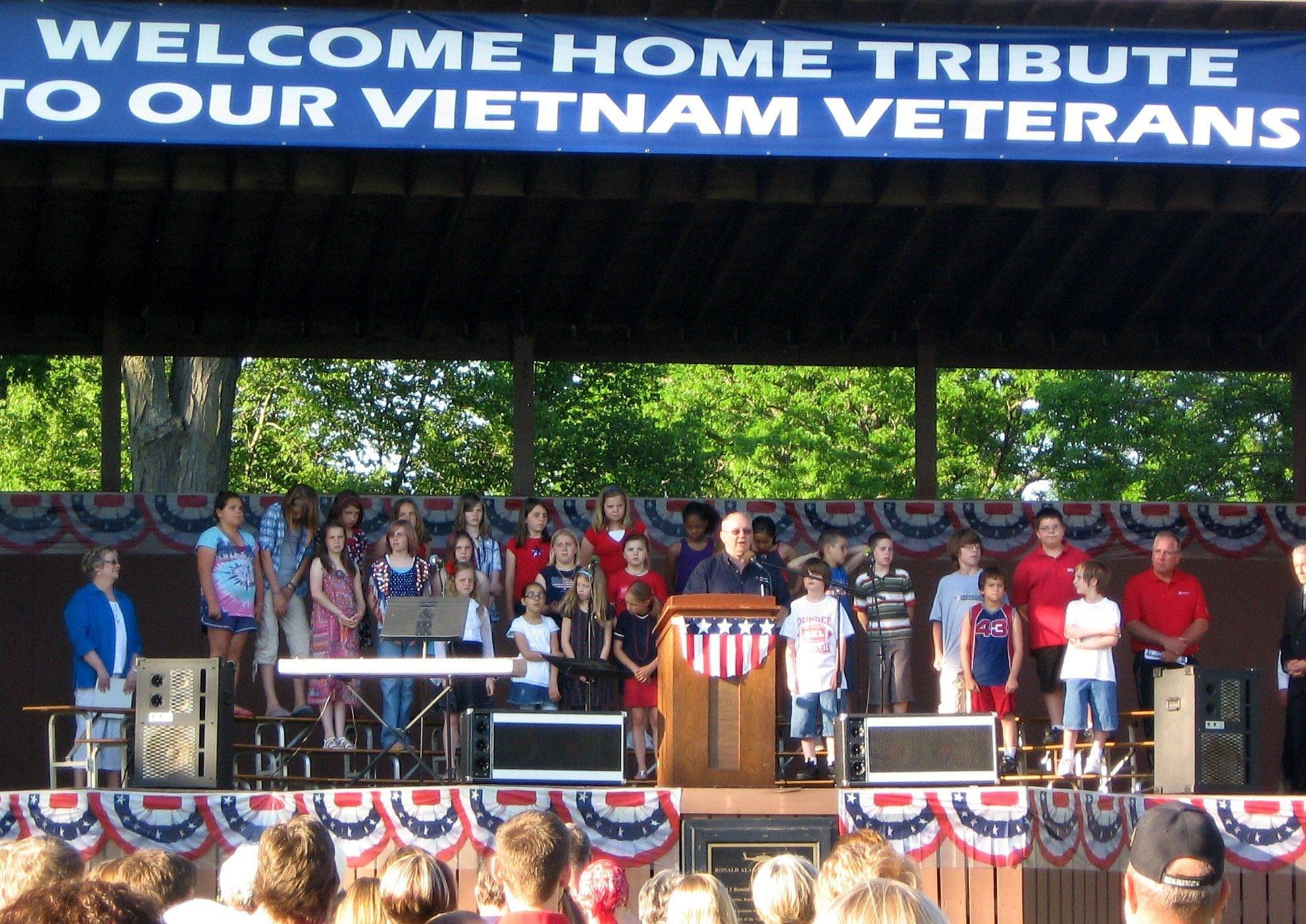 "The Patriot Committee of Dundee Township Chairman Jerry Christopherson welcomes visitors to ""The Healing Field - A Tribute to Our Vietnam Veterans"" now on display in Carpenter Park."