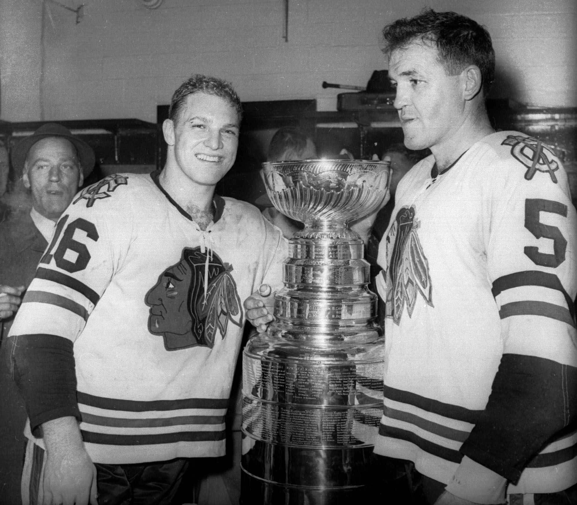 Bobby Hull, left, and Jack Evans of the Chicago Blackhawks, are shown in the dressing room with the Stanley Cup after Chicago won the NHL title by downing the Detroit Red Wings 5-1 in this April 16, 1961 photo, in Detroit.
