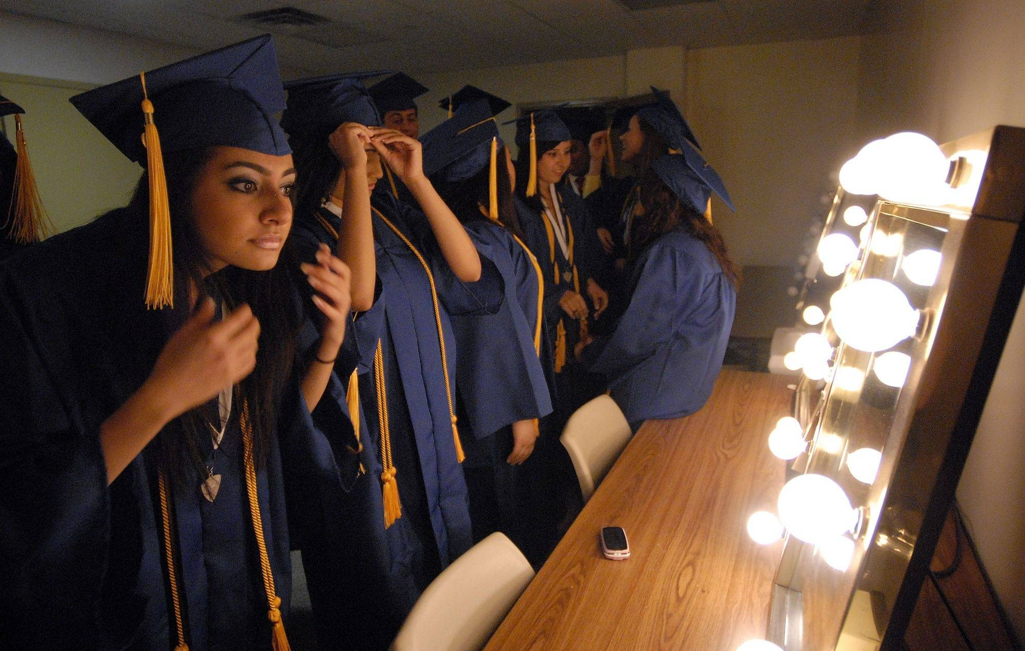 Nelli Choudanian,18, of Des Plaines gets ready for her graduation at the Rosemont Theatre .