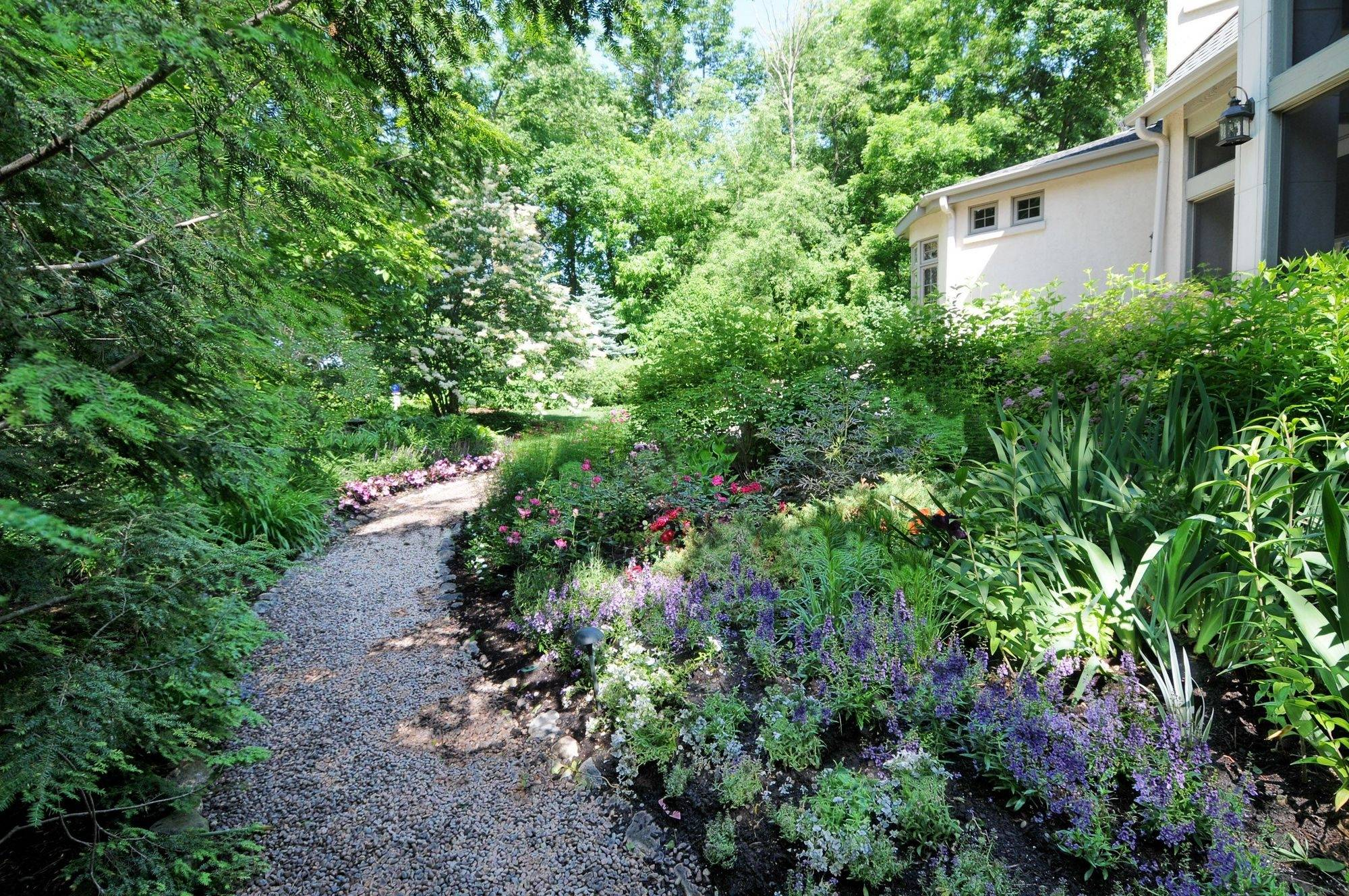 Sue and Dick Lamb's garden affords seclusion and surprises. The yard is part of the Lisle Woman's Club's Garden Gait walk.