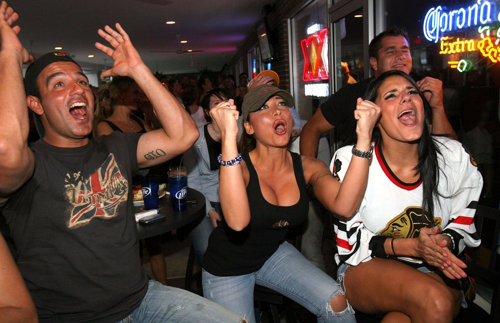 Vince DeLuca of Vernon Hills , Penolope Magouliotis of Vernon Hills and Cali Parisi of Libertyville cheer at Tommy's Pizza and Sports Bar in Libertyville Wednesday night.
