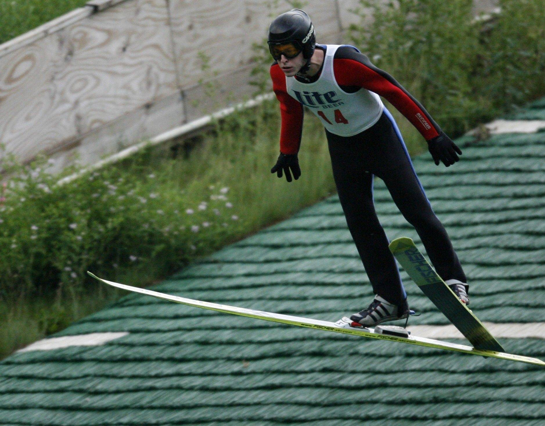 Mike Furey, of Lake Barrington, jumps at the 2008 Norge Ski Club's King of the Hill contest held in Fox River Grove. The club holds jumps in the summer and winter and is the oldest active jump club in the U.S. Jumpers land on an artificial surface that is continually sprayed with water.