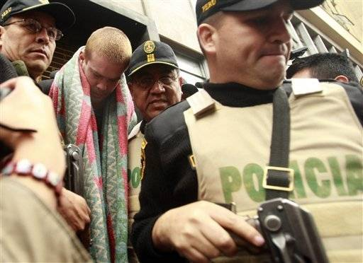 Dutchman Joran van der Sloot, second left, is escorted by police officers in Lima, Friday. According to Peruvian police Van der Sloot has confessed to killing Peruvian citizen Stephany Flores in his Lima hotel room on May 30.