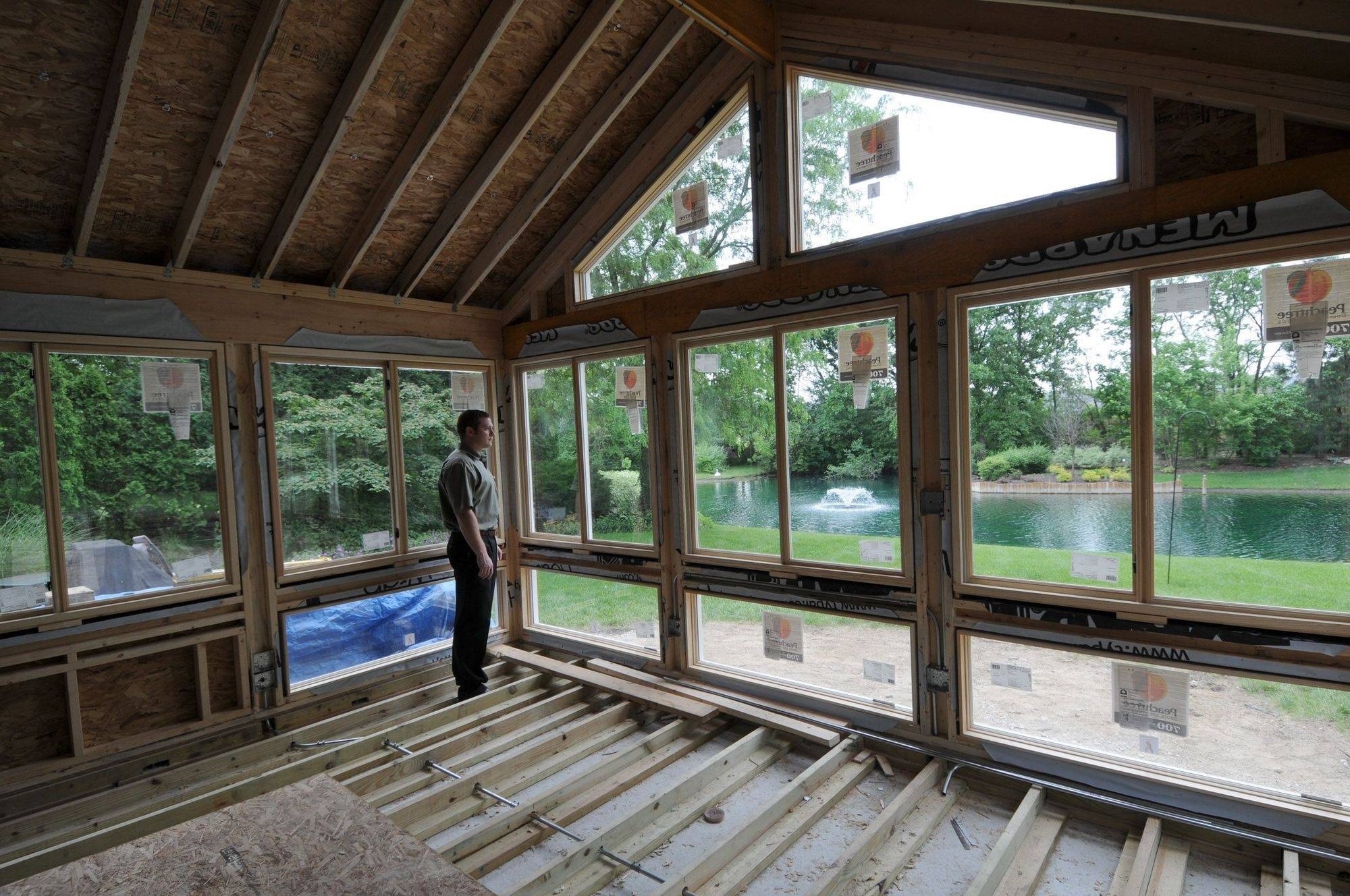 Brian Kinane Of TimberBuilt Rooms Looks Out Of The Sunroom His Company Is  Constructing At A