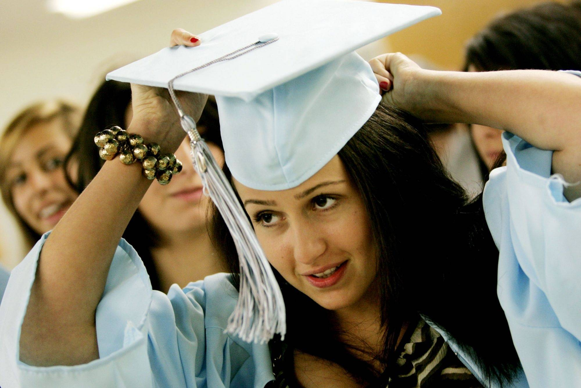 Alexandria Sarovich prepares for the commencement ceremony at Willowbrook High School Sunday in Villa Park.