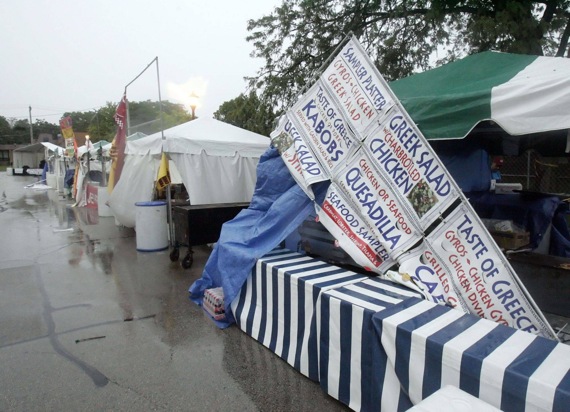 Tents were impacted at the grounds of the Libertyville Days festival .