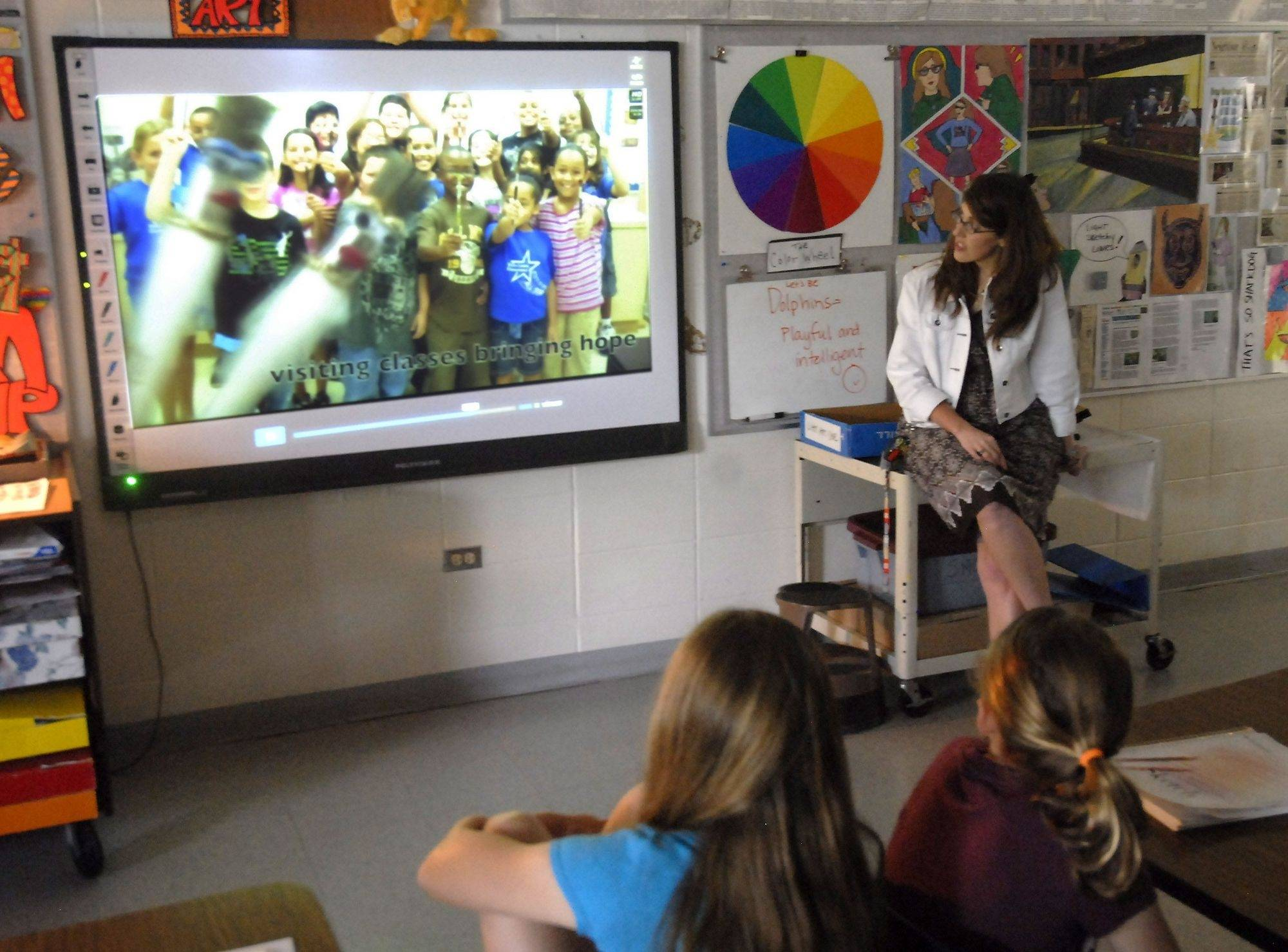 Art teacher Tricia Fuglestad works with students using a SMART Board at Dryden Elementary School in Arlington Heights.