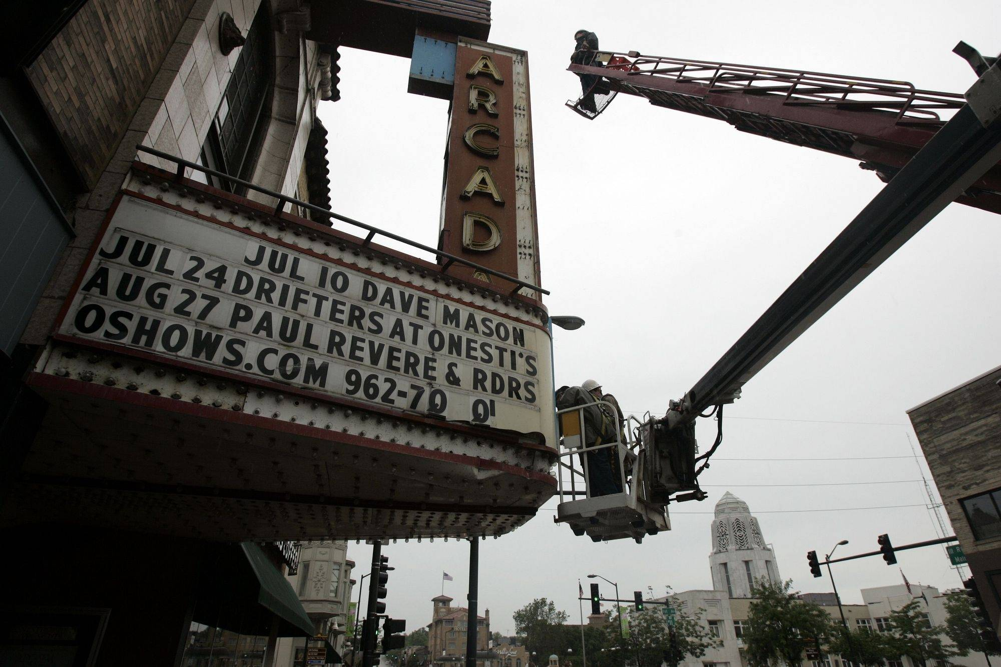 Workers started dismantling the Arcada Theatre marquee Wednesday in downtown St. Charles. Grate Signs, a Joliet company, is doing the work with help from senior design and project manager Linda Stuart, who lives in St. Charles.