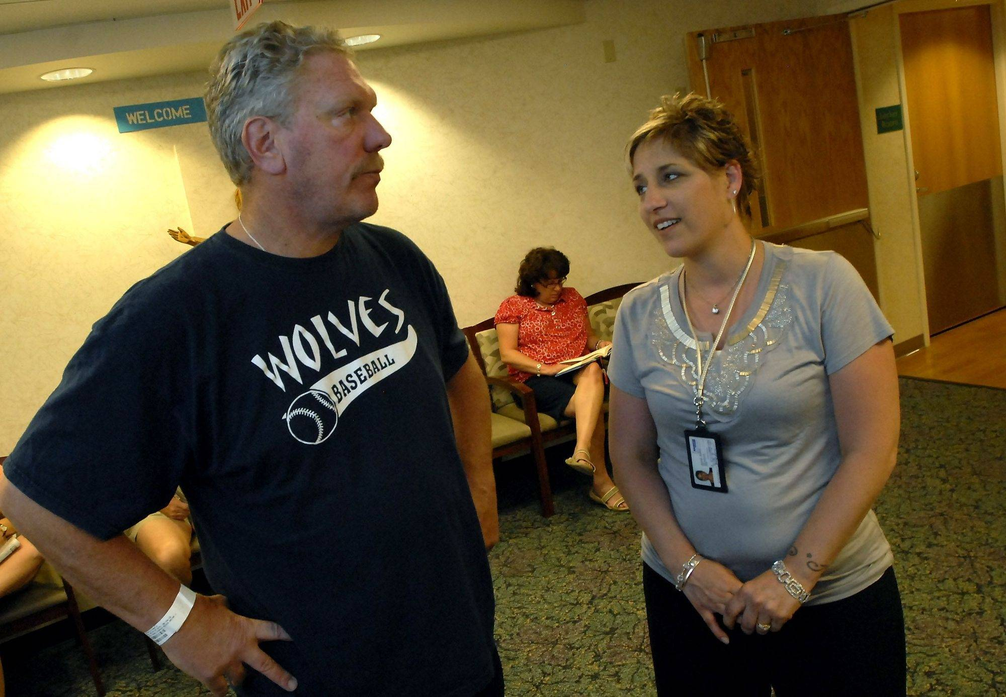 Streamwood Park Board Commissioner Rick Brogan talks with Hanover Township Director of Community Health Trish Simon before getting a colonoscopy Tuesday at Alexian Brothers Medical Center in Hoffman Estates. Simon, a colon cancer patient, organized a drive to get coworkers tested.
