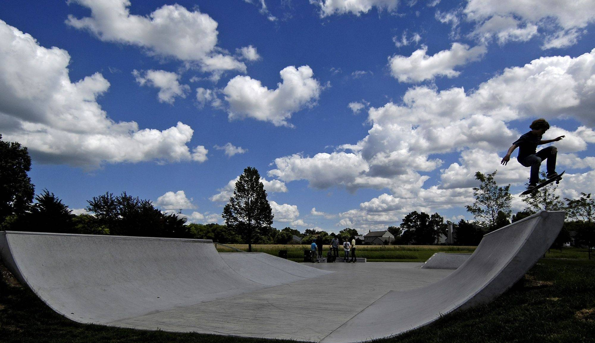 Kids use the skate park at Huffman Park in West Dundee Monday. Neighbors are complaining that the skate park is attracting some unsavory characters who cut through yards and commit petty crimes.
