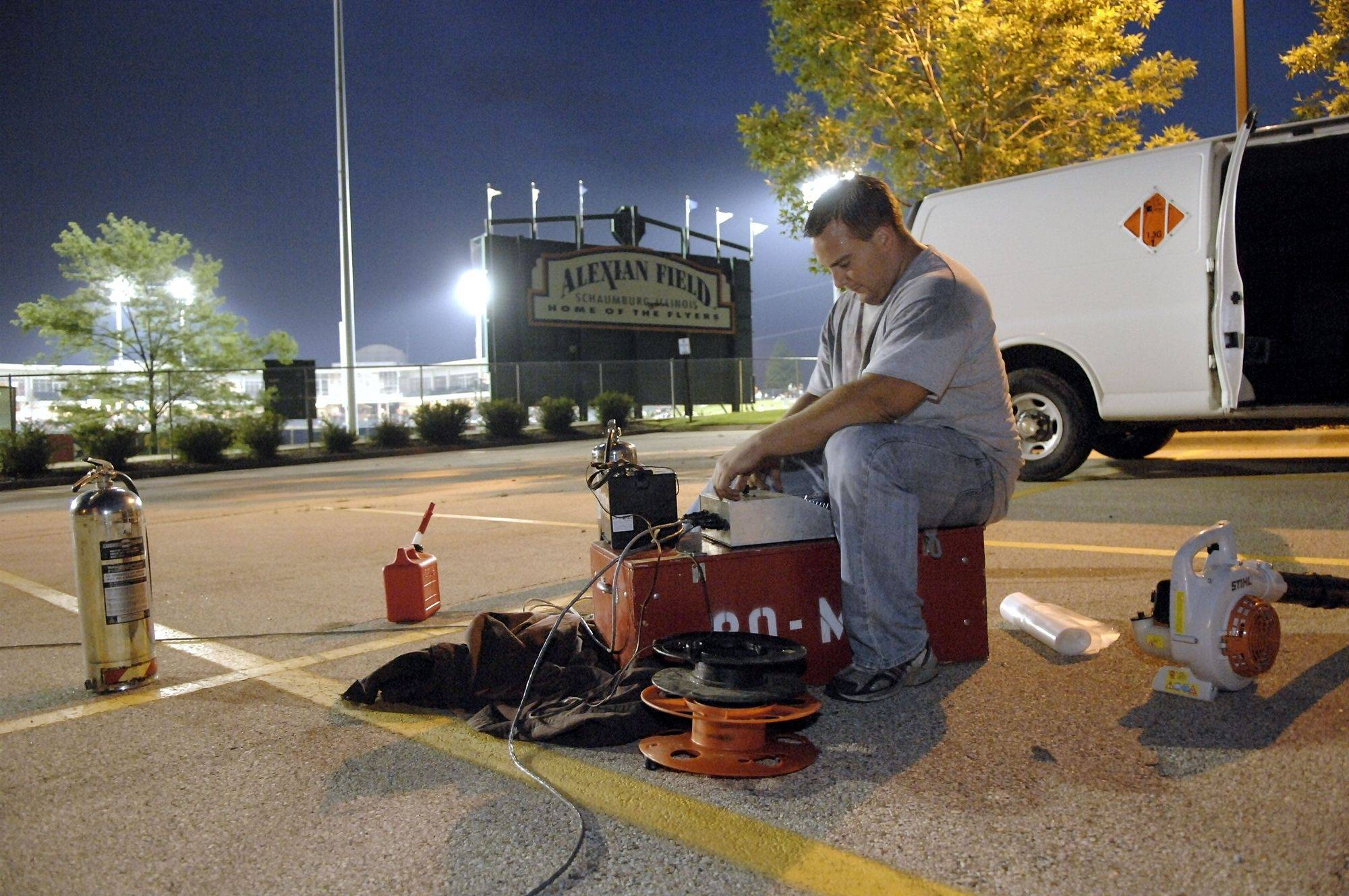 Don Miller, of Mad Bomber Fireworks Productions in Elgin, readies the controls which will be used to ignite the special effects fireworks and finale using a 12 volt battery circuit, at a recent Schaumburg Flyers game.