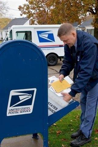 Falling like phone booths, blue mailboxes still deliver