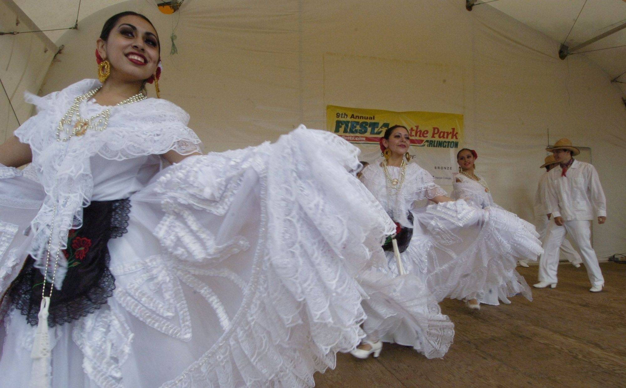 "Dancers from Ballet Folklorico Huehuecoyotl perform during ""Fiesta in the Park"" at Arlington Park Sunday."
