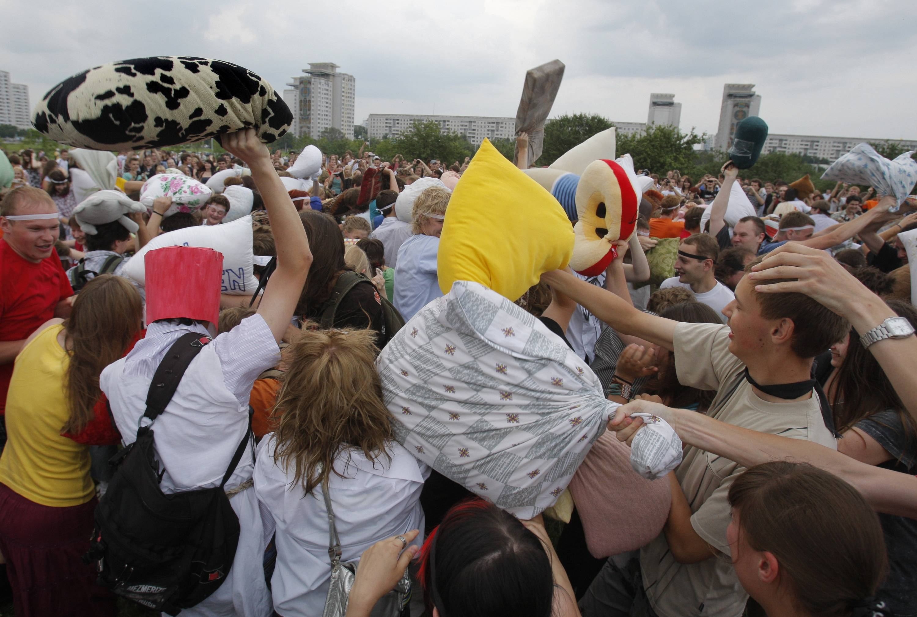 Club-wielding police dispersed about 400 pillow-wielding youths who gathered in Minsk, the capital of Belarus, to humorously commemorate the anniversary of the Battle of Grunwald with pillows.