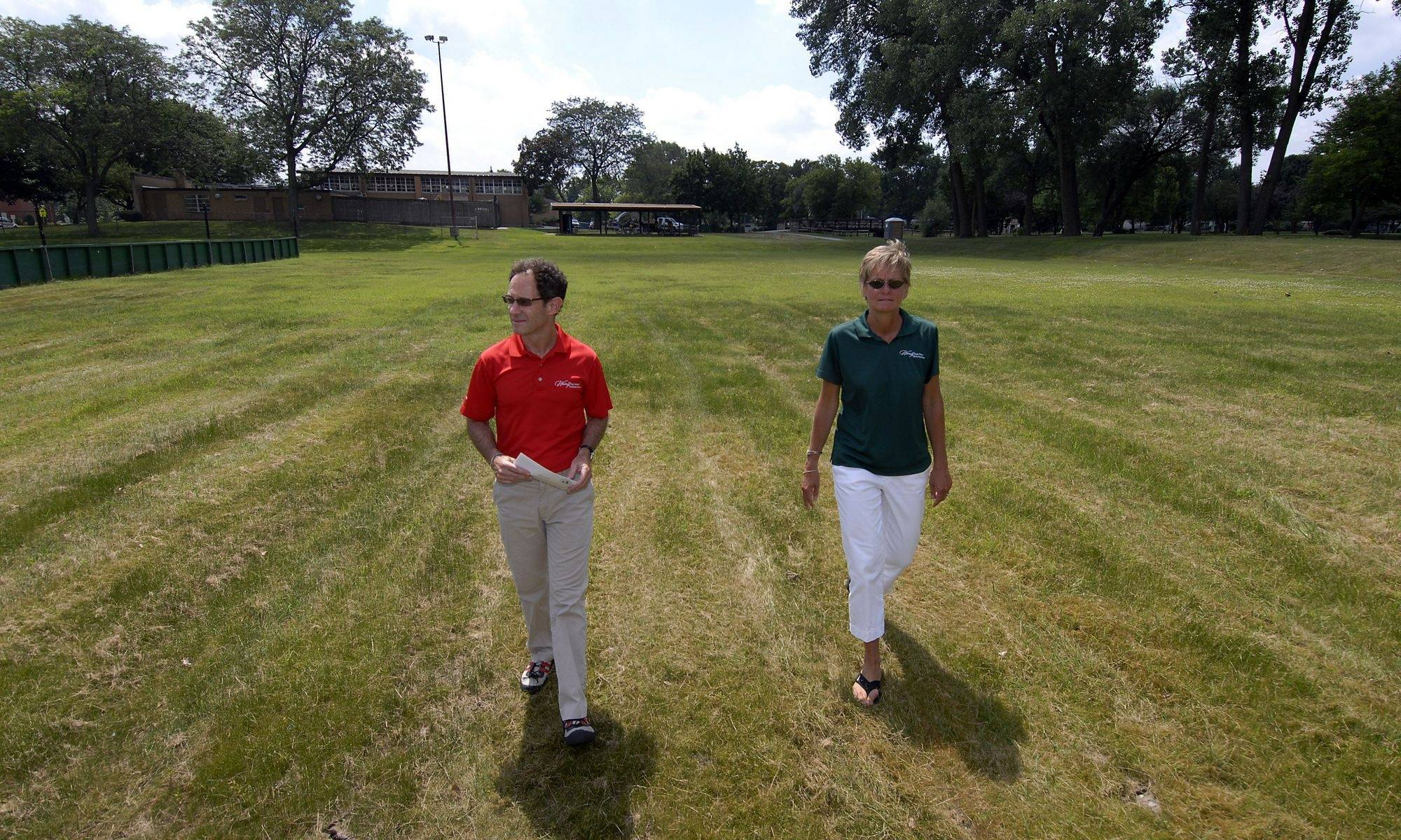 Jan Buchs, executive director of the Wheeling Park District and Larry Raffel, superintendent of planning for the park district, walk in what will be a new reservior at Heritage Park to help alleviate flooding in the area.