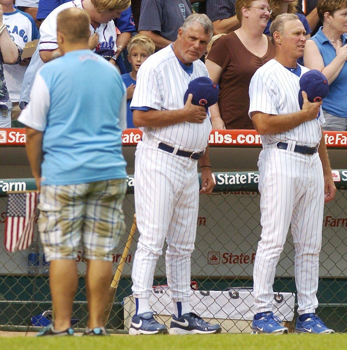 Cubs manager Lou Piniella, center, stands with bench coach Alan Trammell during the singing of the National Anthem prior to Tuesday's game at Wrigley Field.