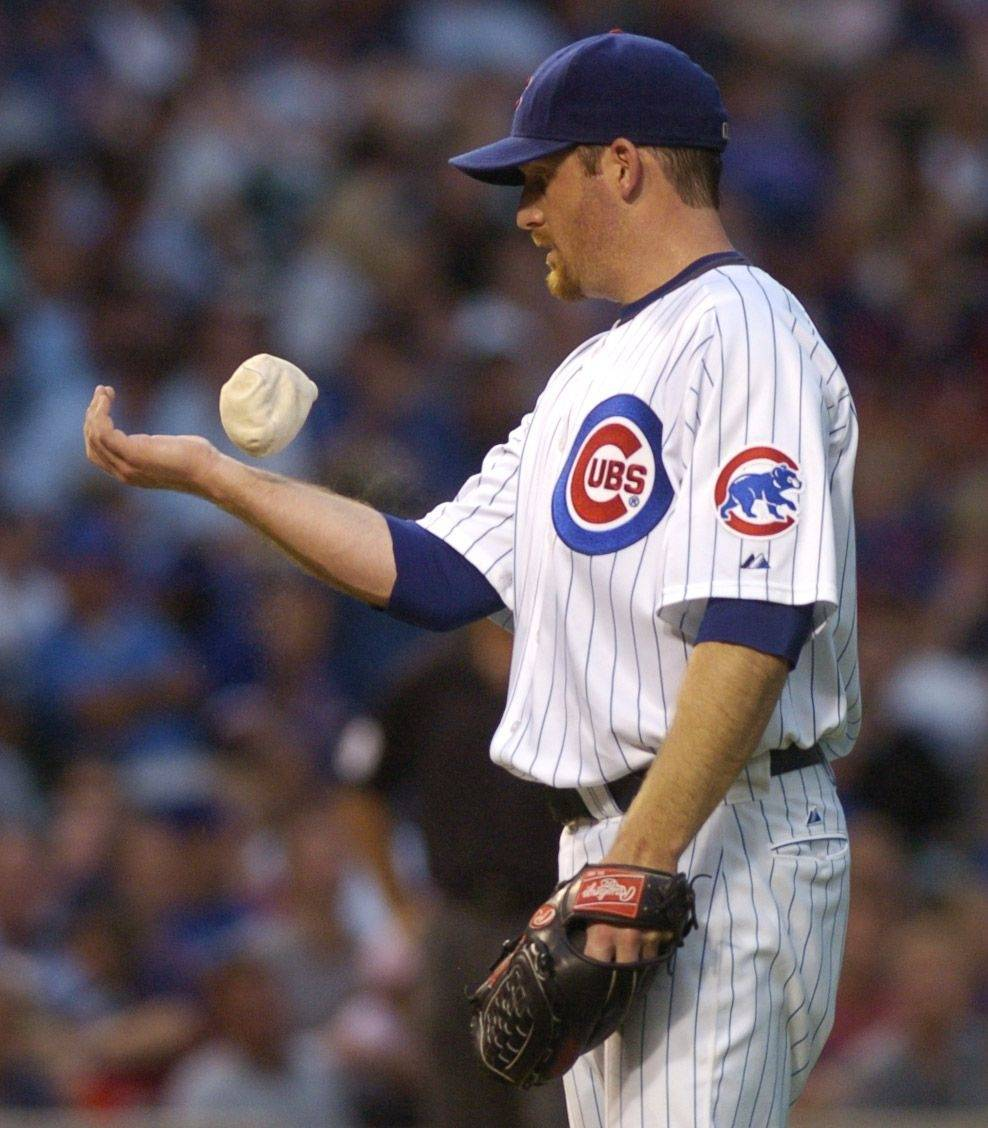 Cubs pitcher Ryan Dempster works the resin bag during the Astors' four-run second inning Tuesday at Wrigley Field.