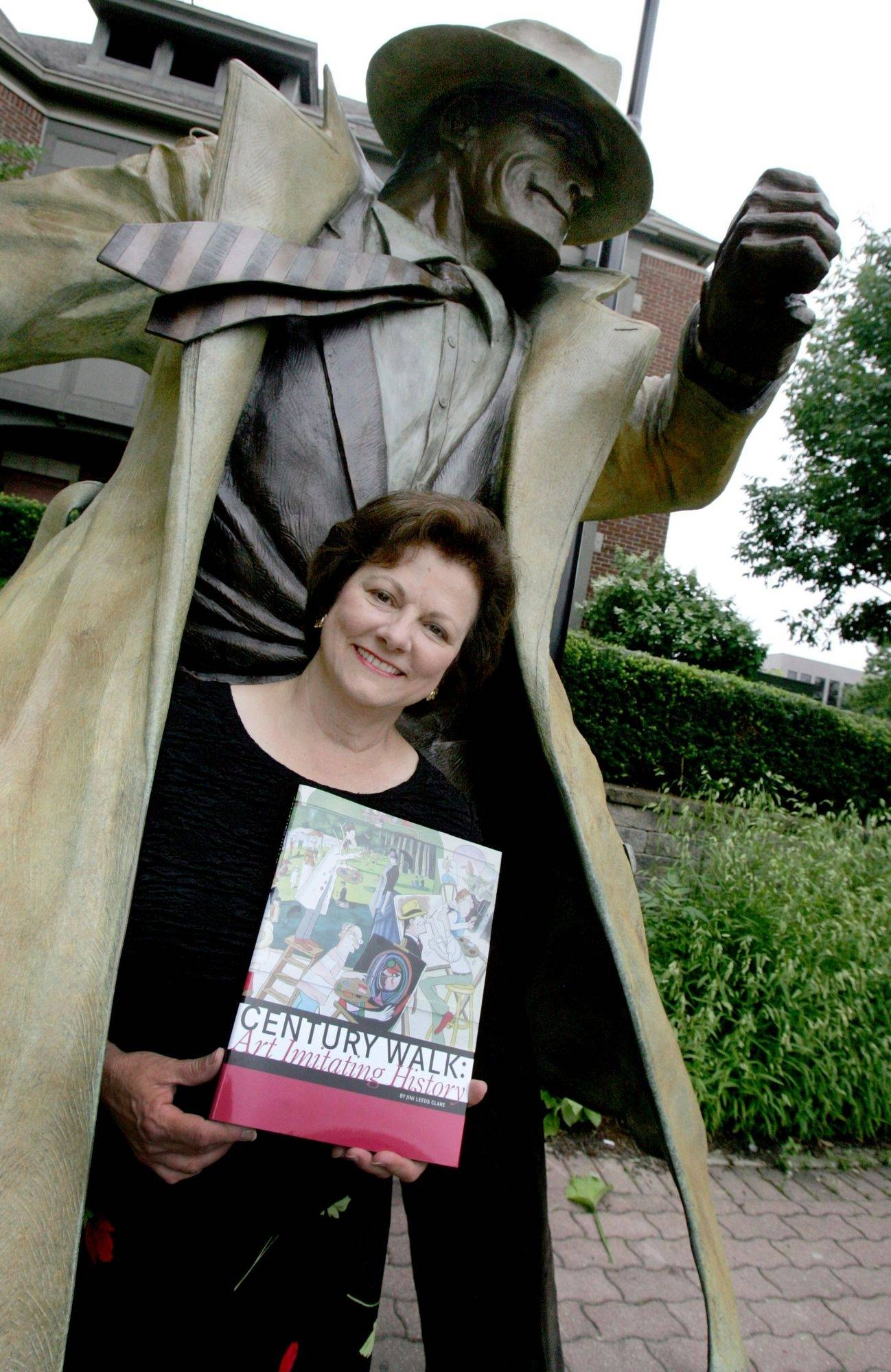 "Jini Clare wrote ""Century Walk: Art Imitating History"" about Naperville's public art project that this year added a sculpture of Dick Tracy. Clare and at least 18 of Century Walk's artists will be at a book signing today at North Central College's Wentz Hall."