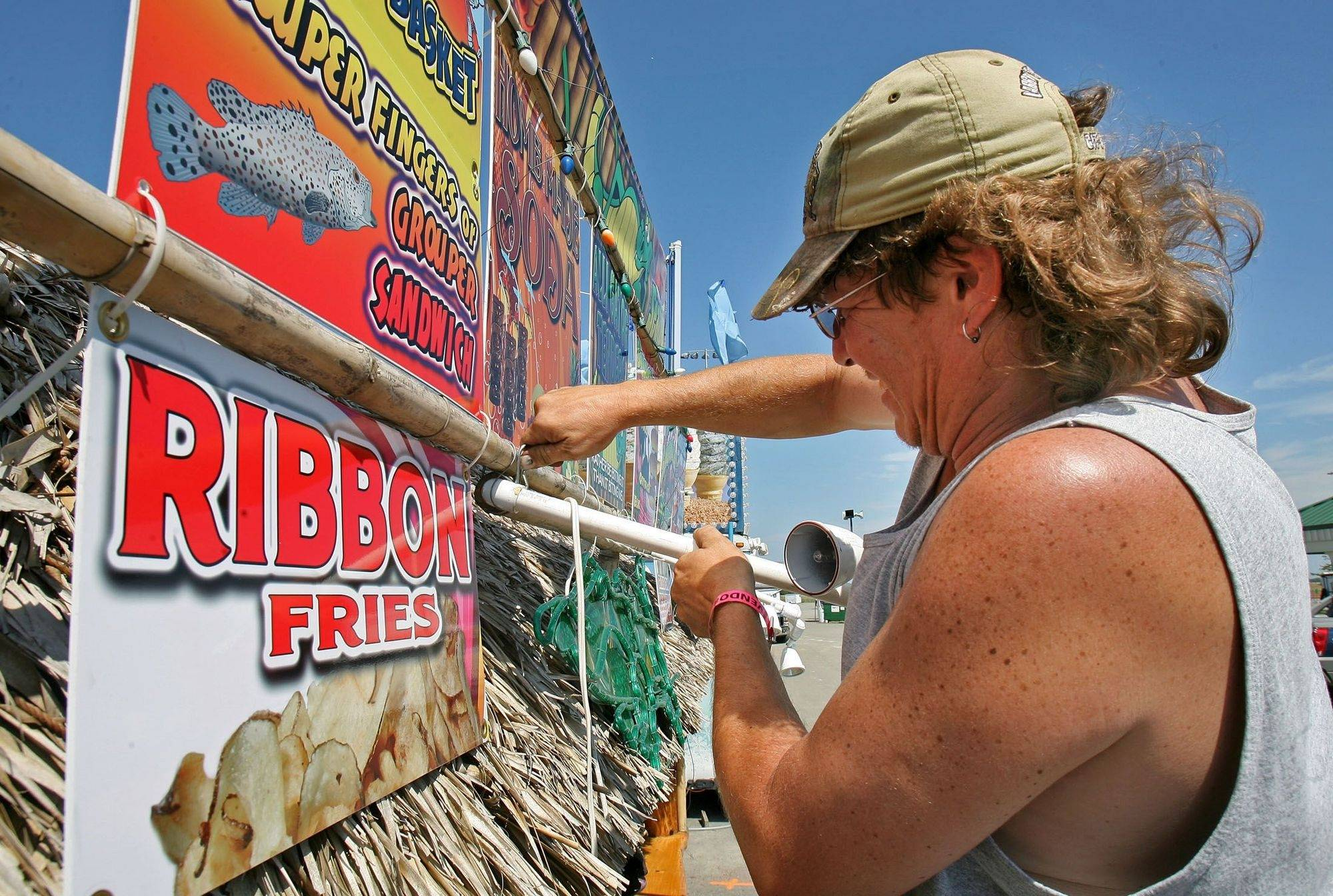 Carl Swandom sets up the Exotic Meats booth as they prepare for opening day of the Lake County Fair in Grayslake.