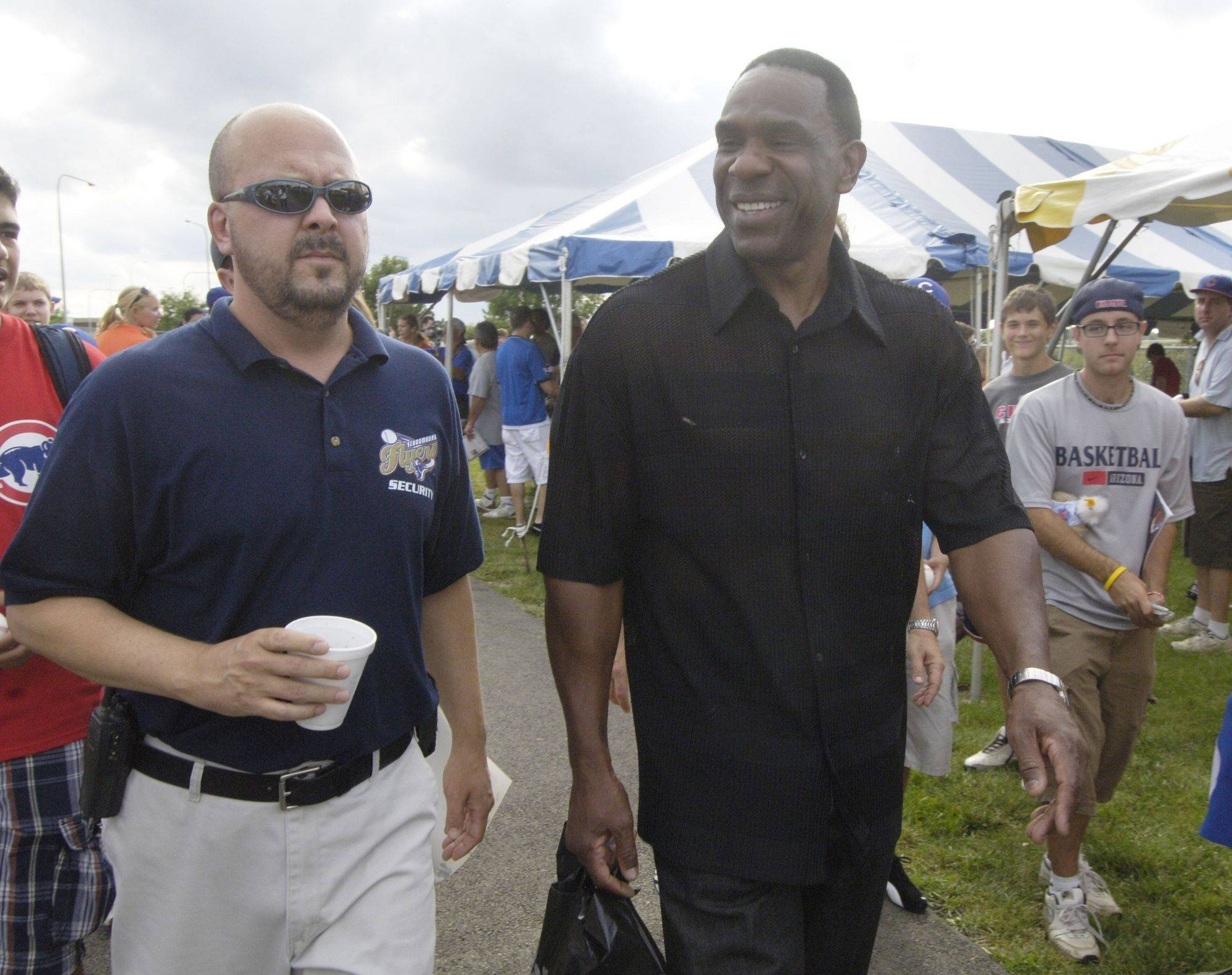 Andre Dawson departs after signing autographs at the Schaumburg Flyers' Alexian Field Wednesday.