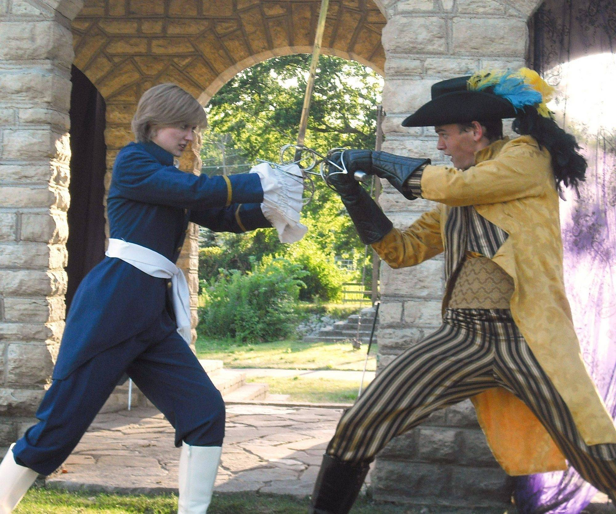 "Actors practice sword fighting for Shakespeare on Clark's production of ""Twelfth Night."""