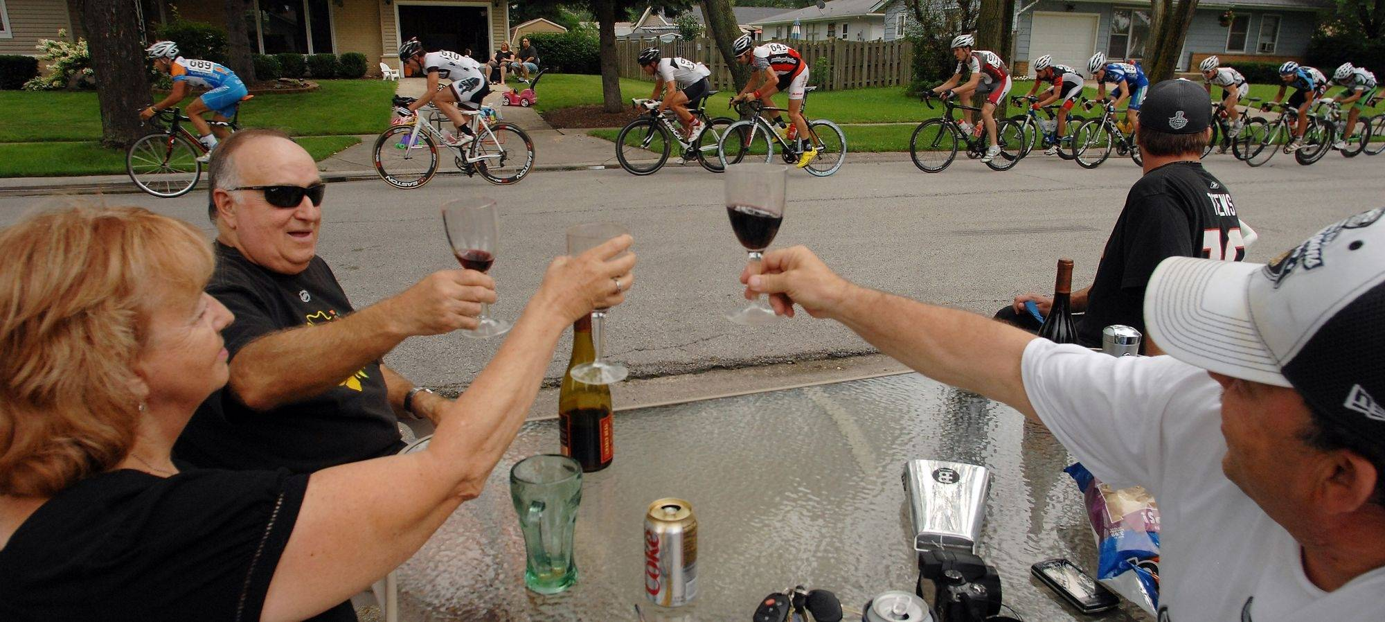 Hoffman Estates Fred Tognocchi and his wife Pat, along with Paul Tognocchi of Elk Grove raise a glass of wine to salute the men's pro racing on Saturday in Elk Grove.