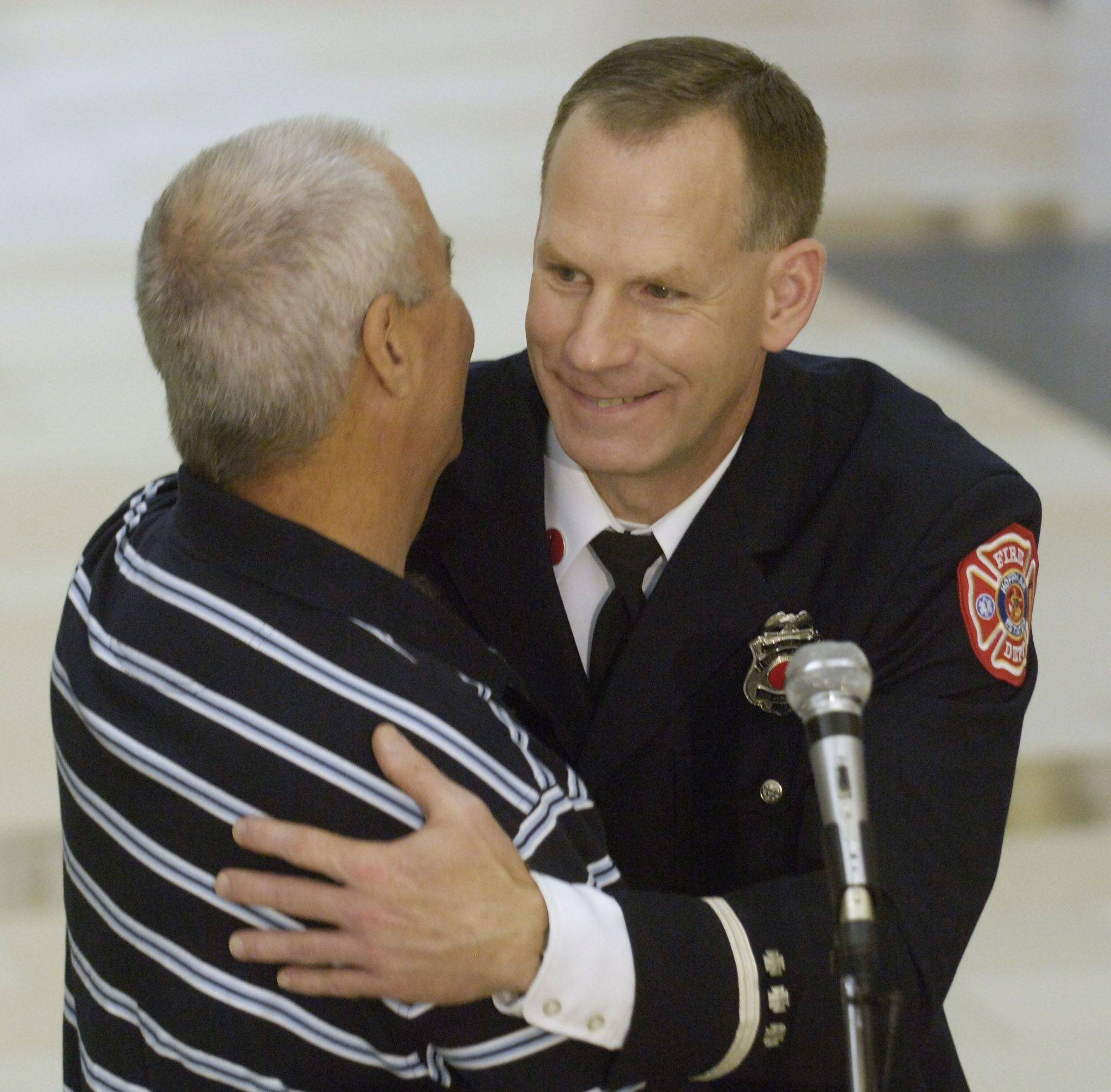 Jack Rosenberg of Arizona, left, hugs Lt. Don Richter of the Hoffman Estates Fire Department during a gathering at the Hoffman Estates Village Hall Saturday. Richter made a bone marrow donation five years ago that saved Rosenberg's life.