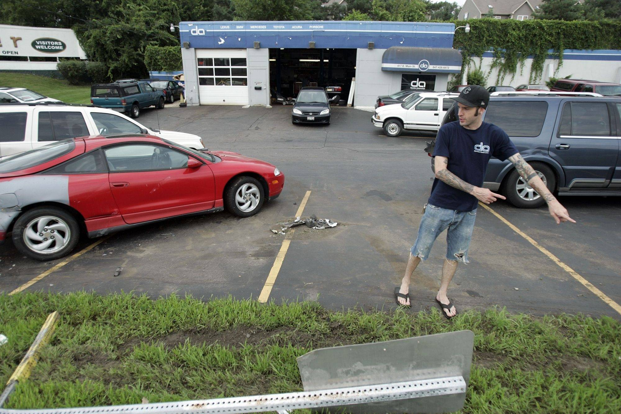 Greg Klemm of Dundee Automotive in East Dundee talks about the 10th time a driver has failed to navigate the curve on Route 72 and plowed through the lot.