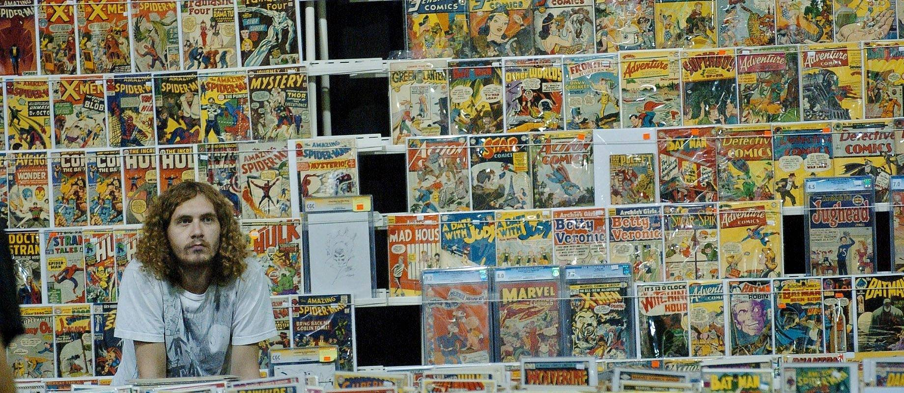Al Stoltz of Basement Comics from Falls Church, Va., is set up with his comic stand.