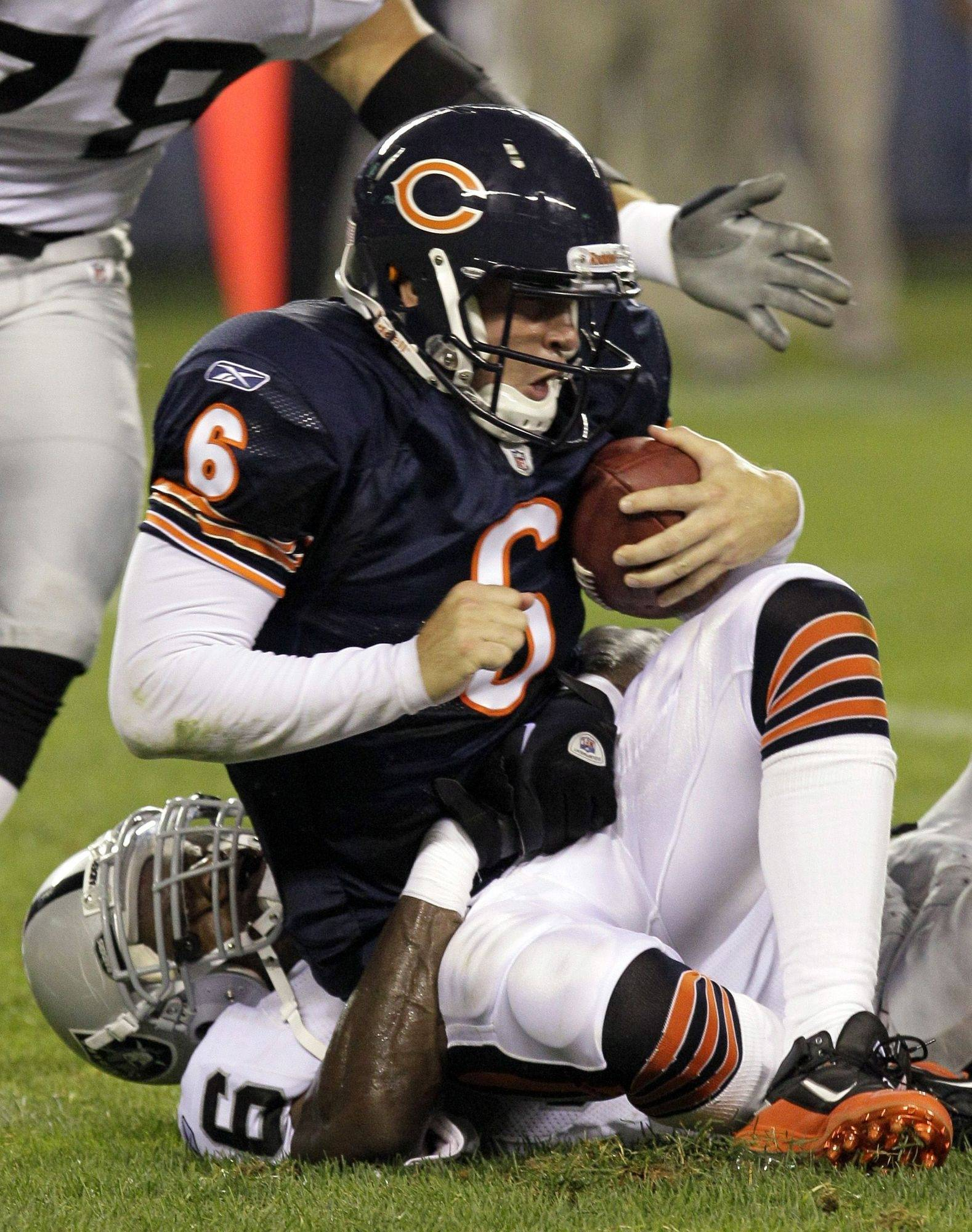 Jay Cutler is sacked by Oakland linebacker Kamerion Wimbley on Saturday at Soldier Field. It was one of five times the Raiders sacked Cutler.