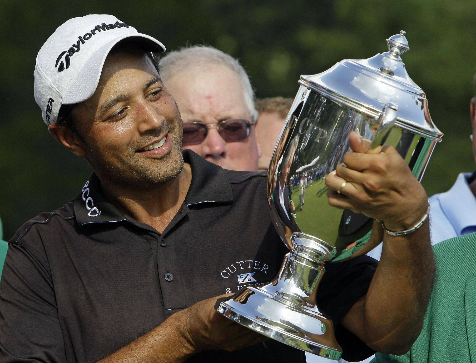 Arjun Atwal holds the Sam Snead Cup on the 18th green after winning the Wyndham Championship golf tournament in Greensboro, N.C., Sunday.
