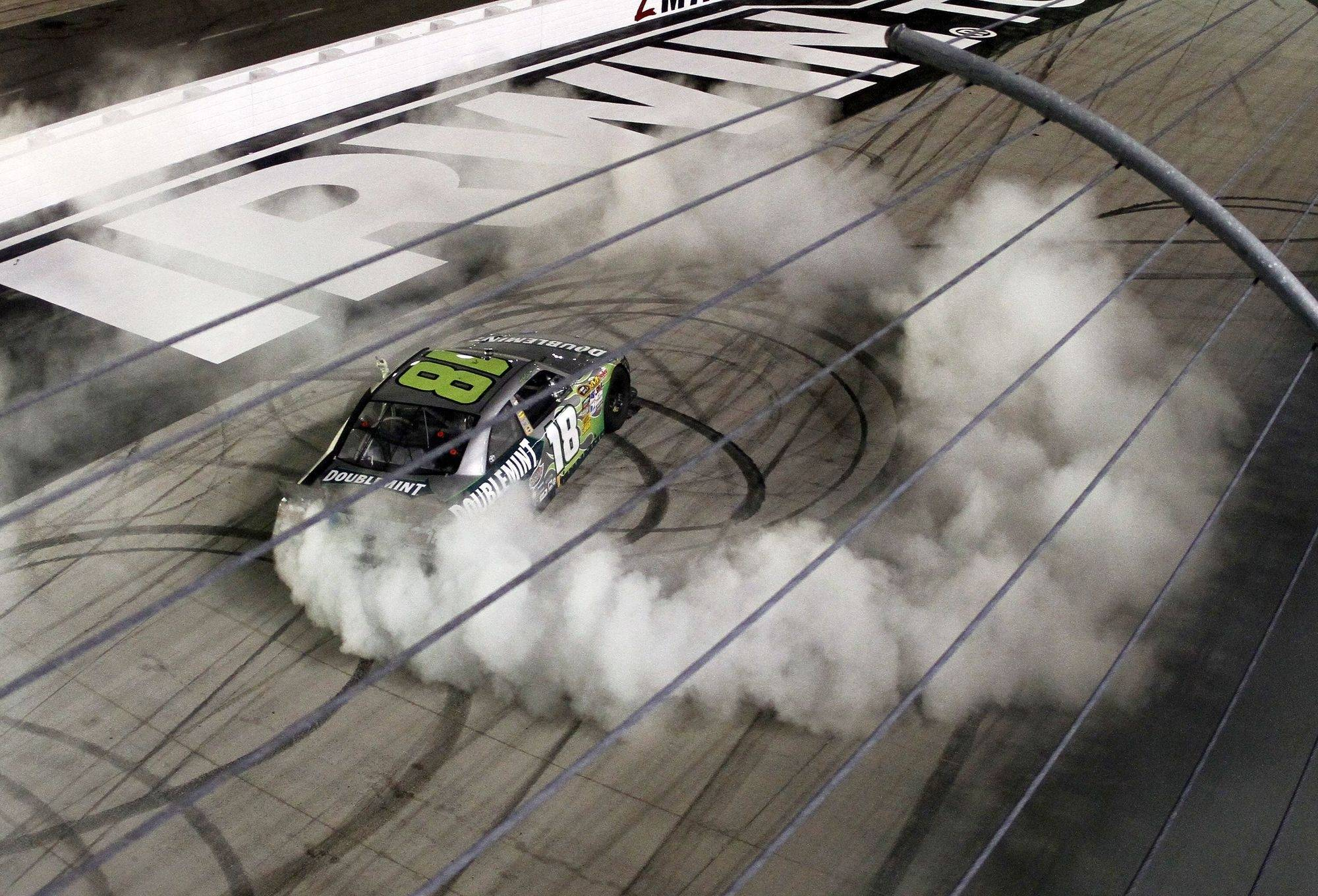 Kyle Busch does a burnout after winning the NASCAR Irwin Tools Night Race on Saturday in Bristol, Tenn. Busch won all three races held at Bristol this week.