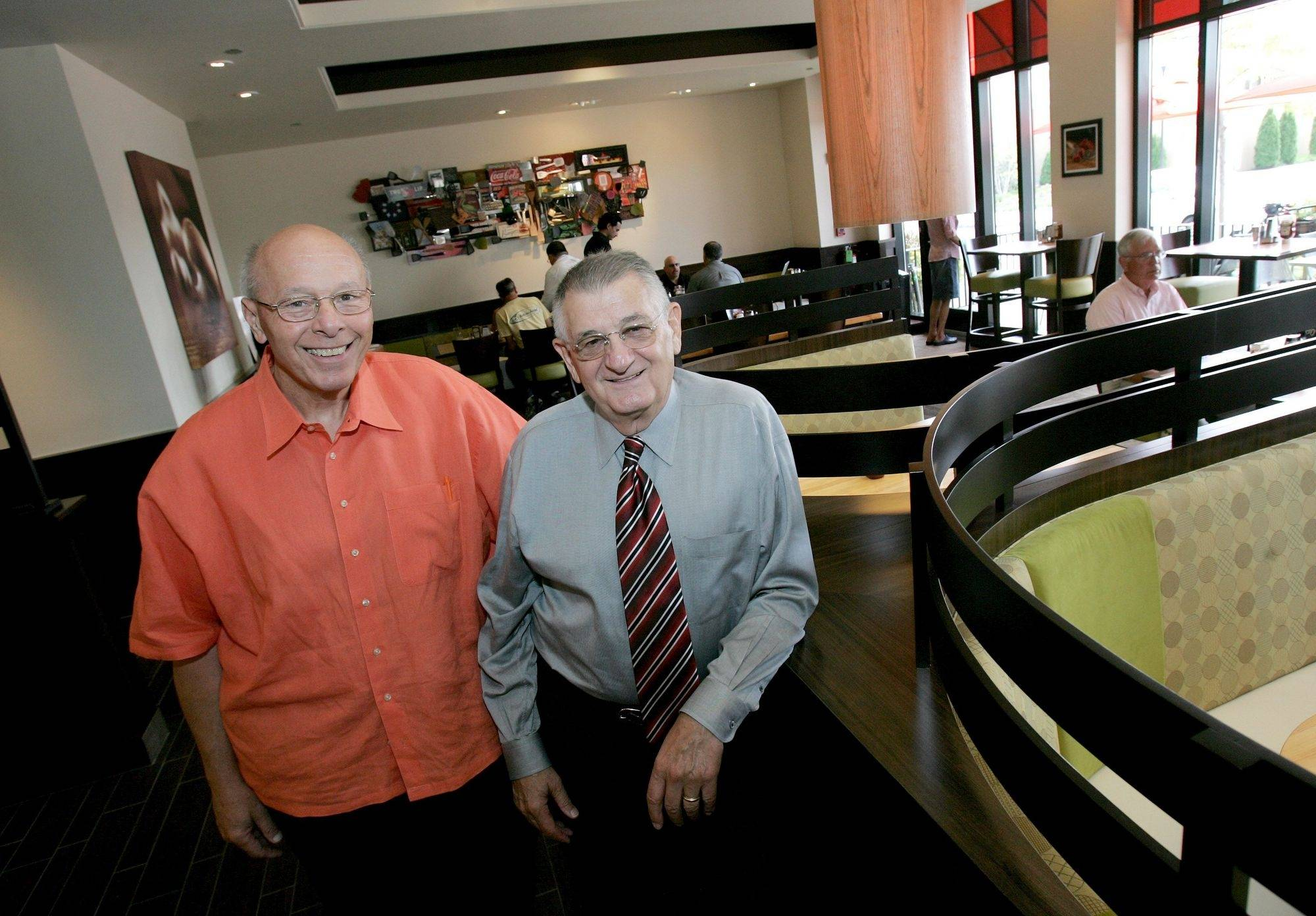 Ed Rensi, left, and Tom Dentice, retired McDonald's executives, are opening a gourmet burger restaurant Friday in Lombard.