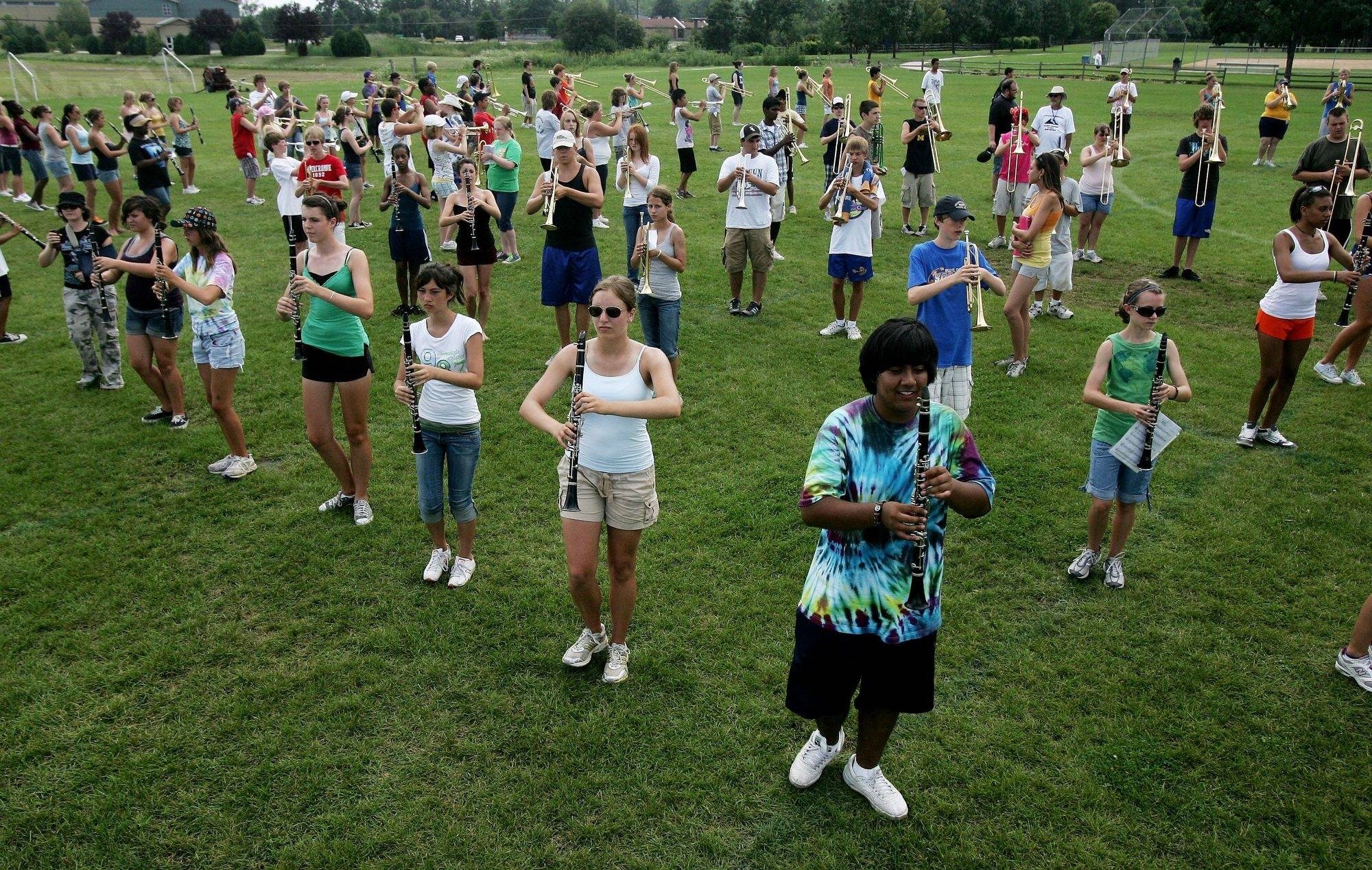 The marching band practices at Warren Township High School in Gurnee. This year, directors formed one marching band that they say is the largest in the state.