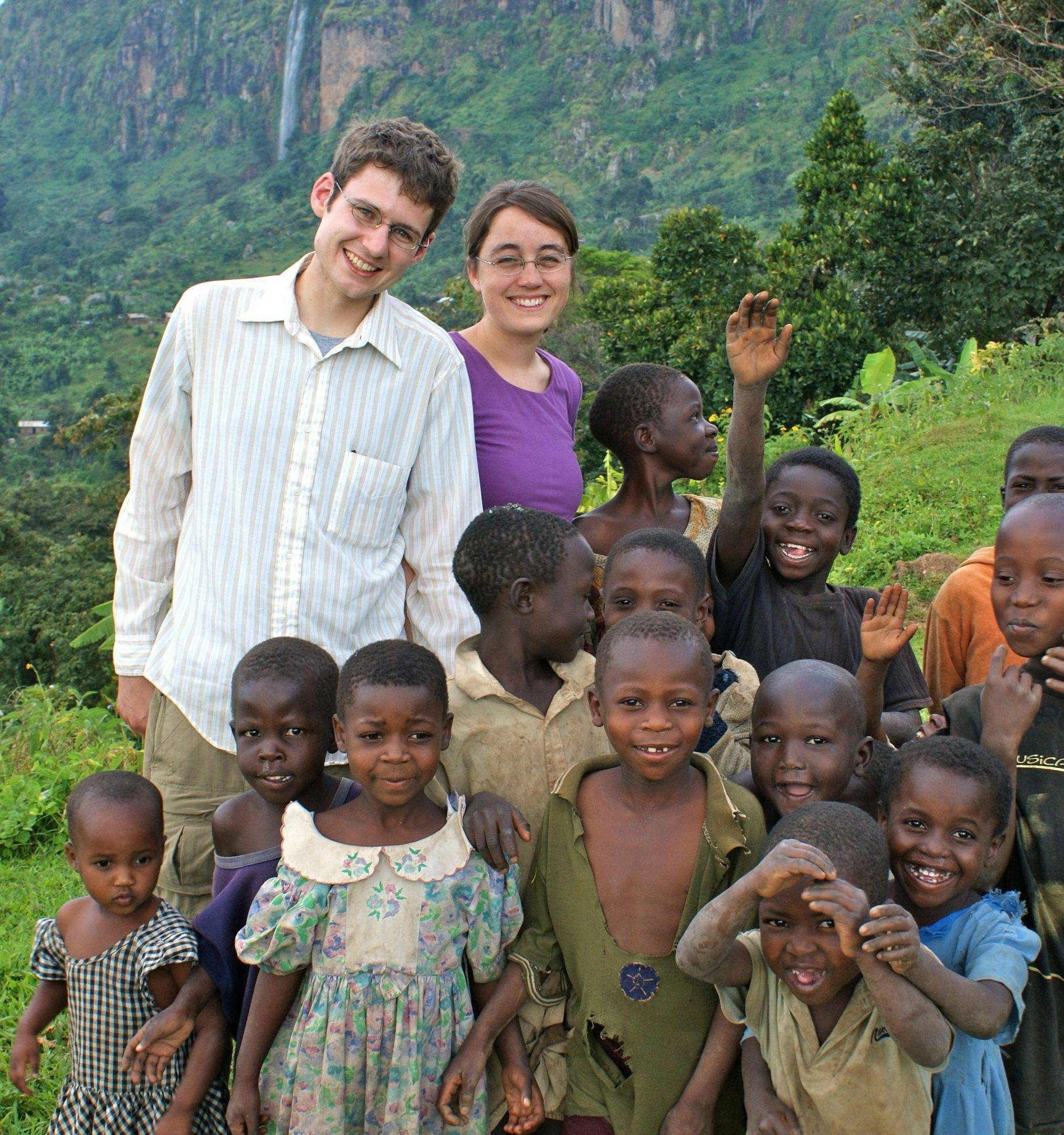 Jim and Margaret Guzzaldo with several children from a Ugandan village during trip in late 2008. They are both 1999 graduates of St. Charles High School.