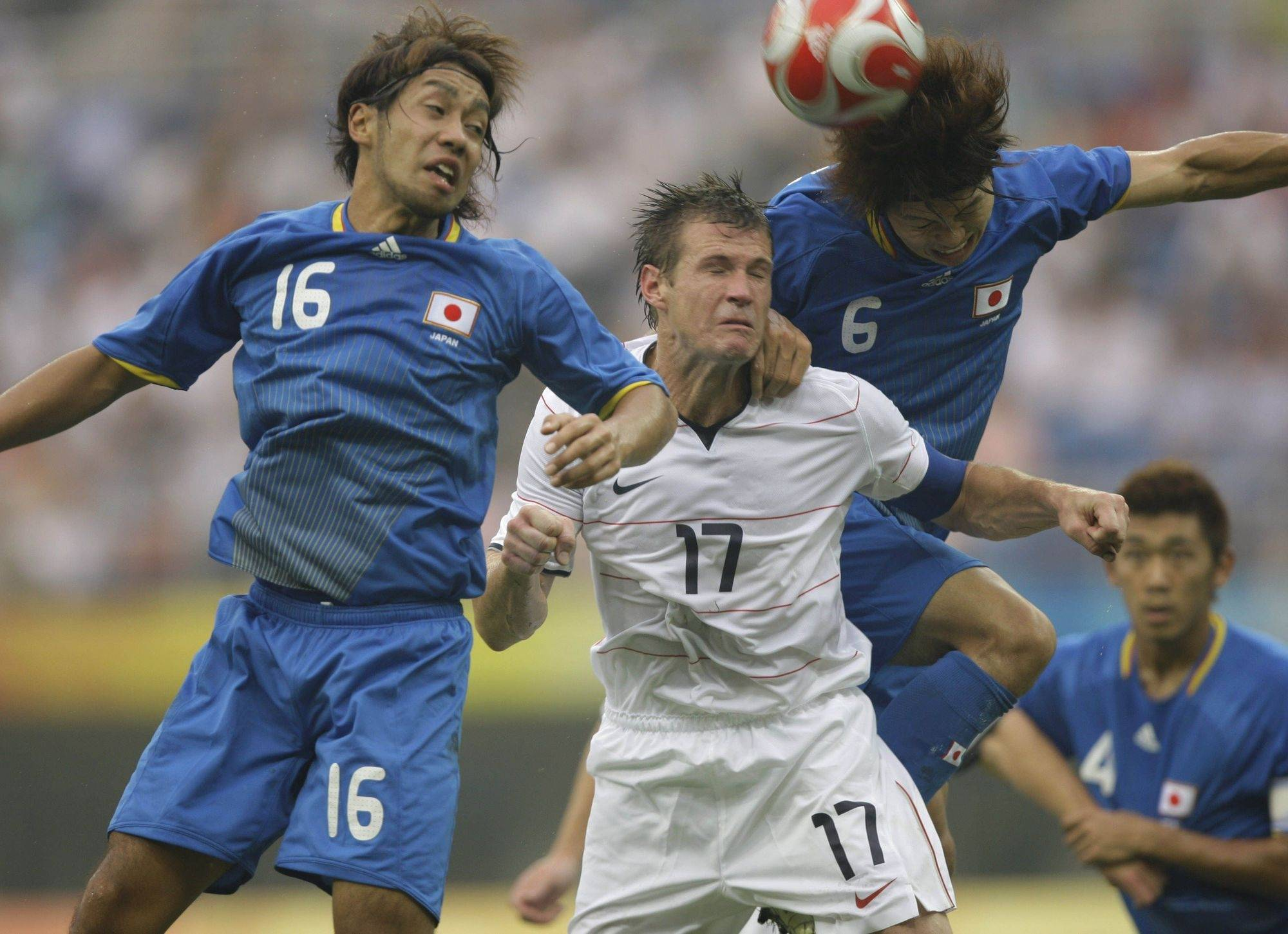 Japan's Takuya Honda (16) and Masato Morishige (6) challenge for the ball against United States' Brian McBride (17) during a Group B Men's Soccer match at the Beijing 2008 Olympics in Tianjin, China Thursday, Aug. 7, 2008.
