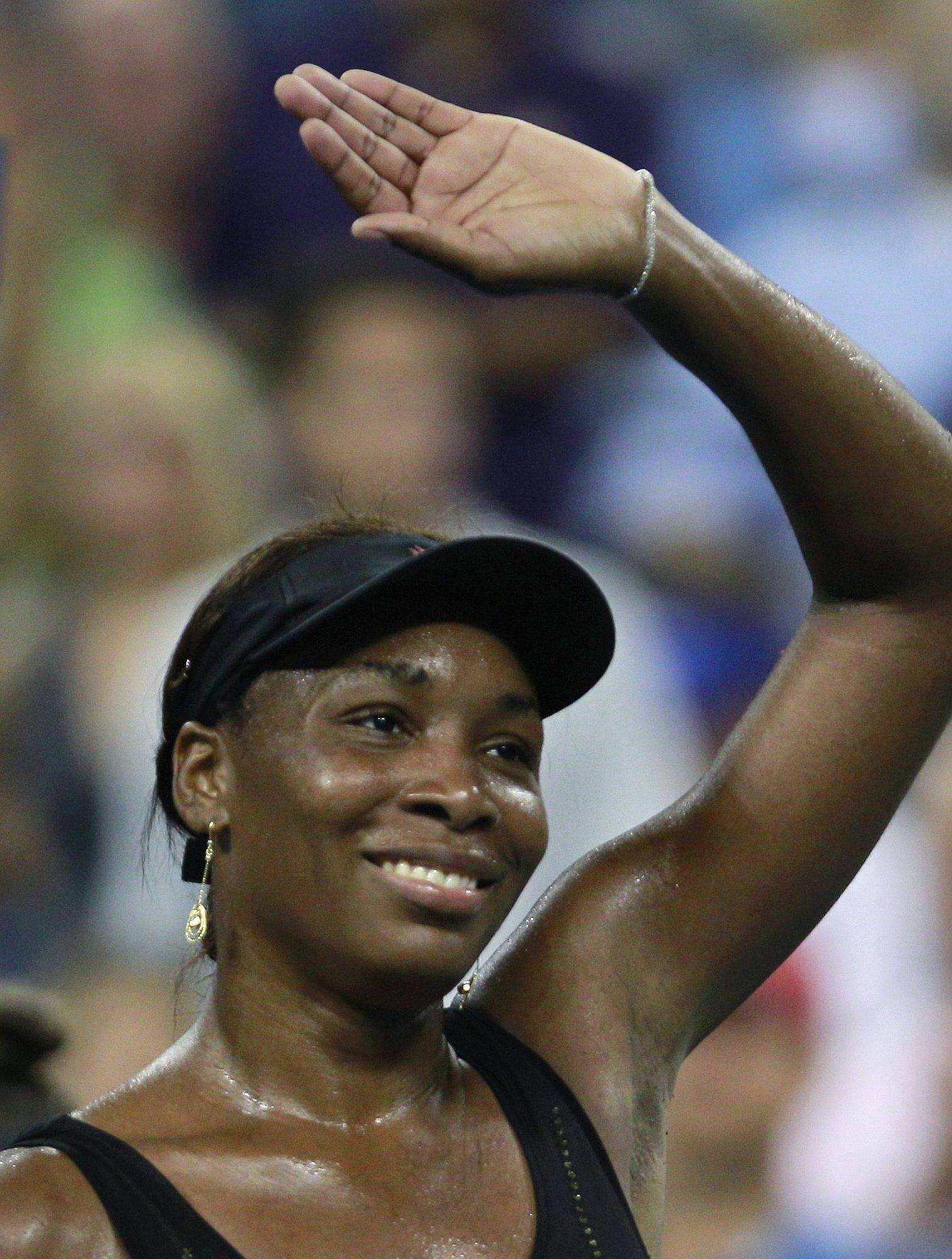 Venus Williams waves to the crowd after her 6-2, 6-1 win over Mandy Minella, of Luxembourg, at the U.S. Open tennis tournament in New York, Friday.