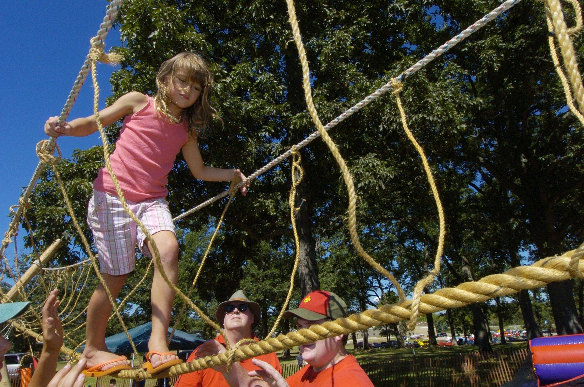 Rachel Gazdzicki, 6, of Round Lake makes her way across the Boy Scout Troop 275 monkey bridge during the Round Lake Hometown Fest Saturday.