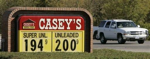 Traffic passes a Casey's convenience store sign in Des Moines, Iowa. Casey's General Stores said Thursday it is in talks with convenience store giant 7-Eleven about a possible buyout.