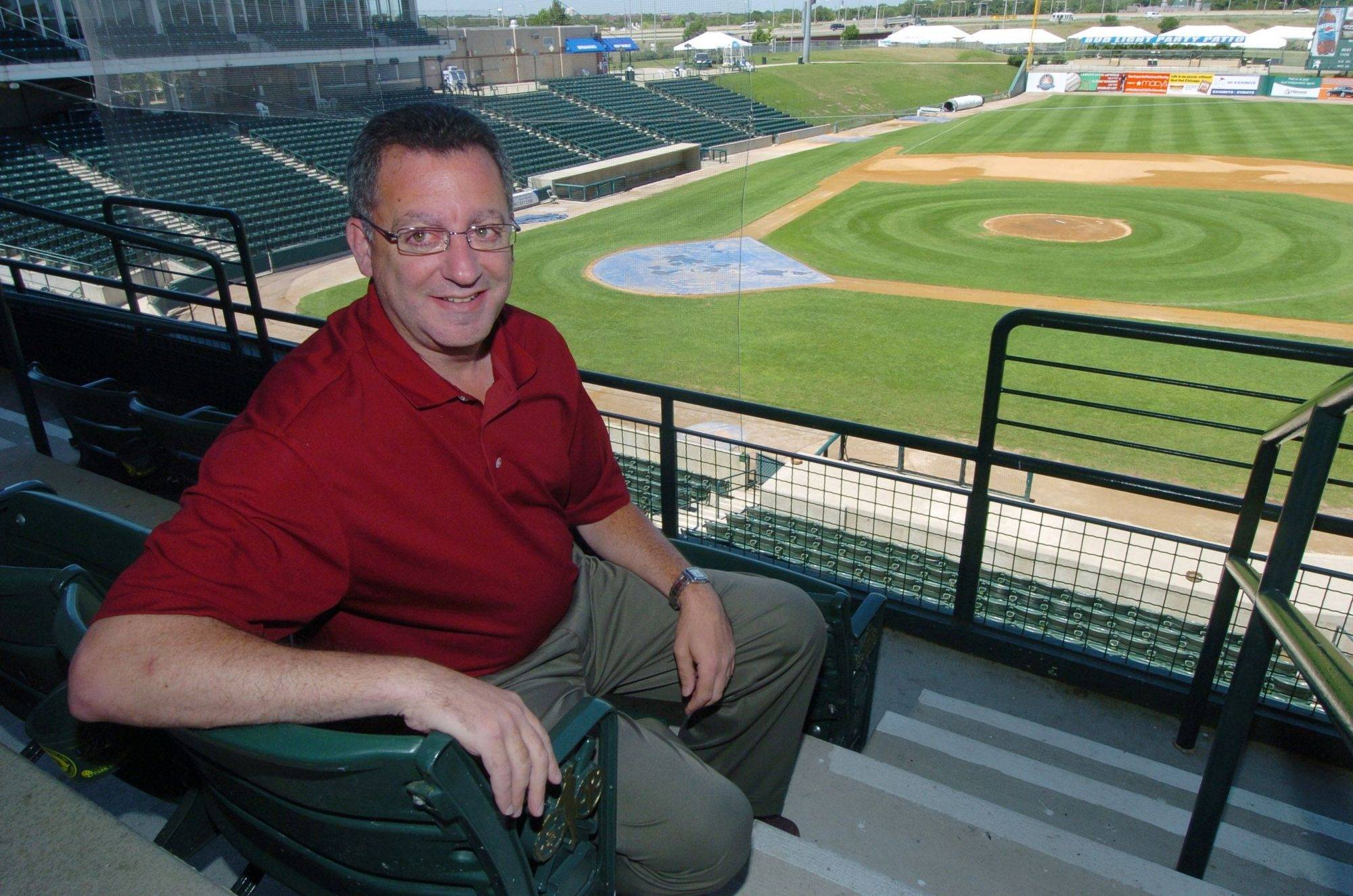 Schaumburg Flyers managing partner Rich Ehrenreich sits outside one of the suites at Alexian Field.