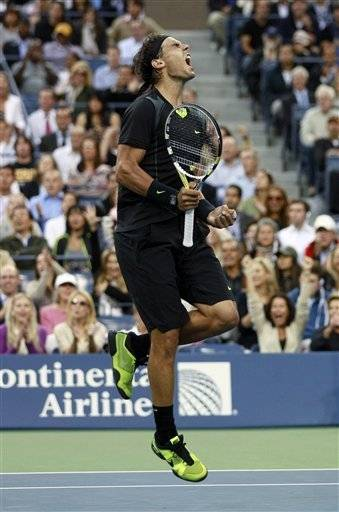 Rafael Nadal, of Spain, reacts after breaking the serve of Novak Djokovic, of Serbia, during the men's championship match at the U.S. Open tennis tournament in New York, Monday.