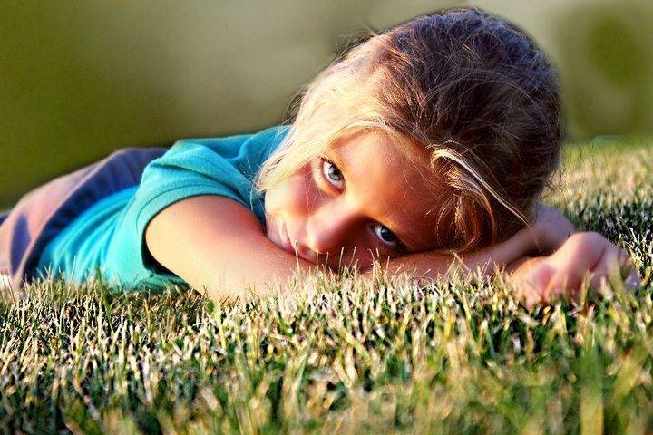 Photo of my daughter Meghan laying in the grass at Tures Park in Huntley on a Sunday afternoon.