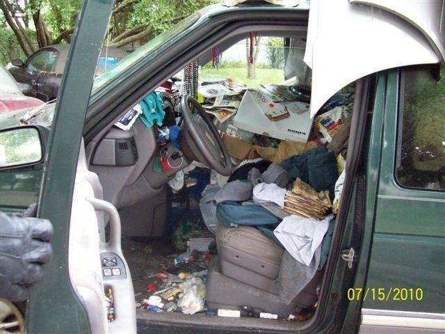 The cluttered interior of one of the cars parked in John Wuerffel's Schaumburg driveway, in a photograph presented as evidence at his recent trial. He's since cleaned up the driveway.