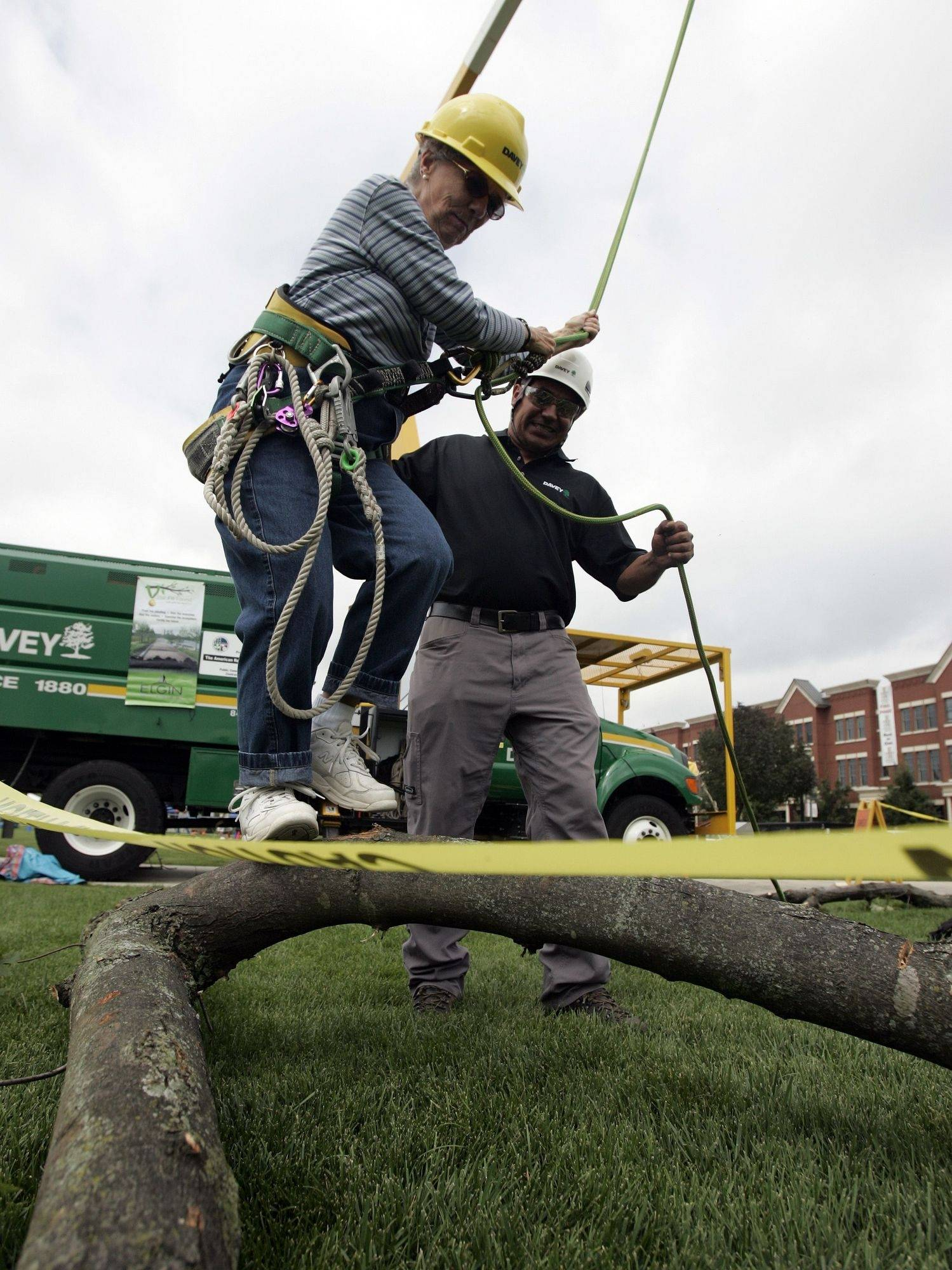 Joyce Hopper of Elgin gets a helping hand form Miguel Alvarez of Davey Tree as she tries to stay upright on a tree limb. There were also music, games, food and fun at Elgin's Largest Block Party at Festival Park Elgin Saturday, September 11.