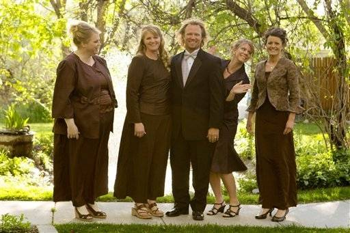 "Tthe Browns, from left, Janelle, Christine, Kody, Meri, and Robyn from the TLC series, ""Sister Wives."" C, Bryant Livingston)"