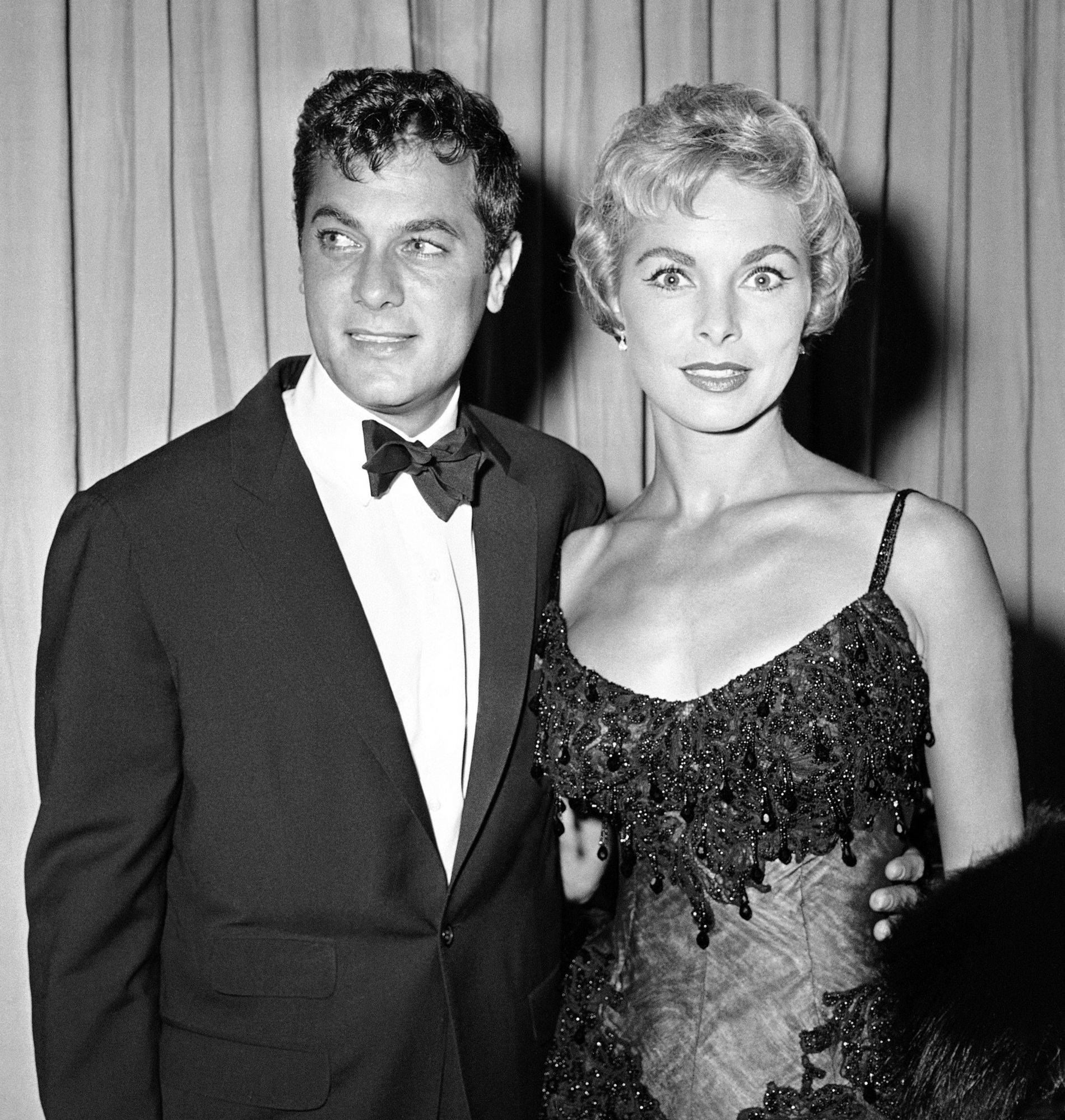 Actor Tony Curtis and his wife Janet Leigh are shown at Academy Awards, in this April 6, 1959 file photo taken in Hollywood. Curtis died Wednesday Sept. 29, 2010 at his Las Vegas area home of a cardiac arrest at 85 according to the Clark County, Nev. coroner.