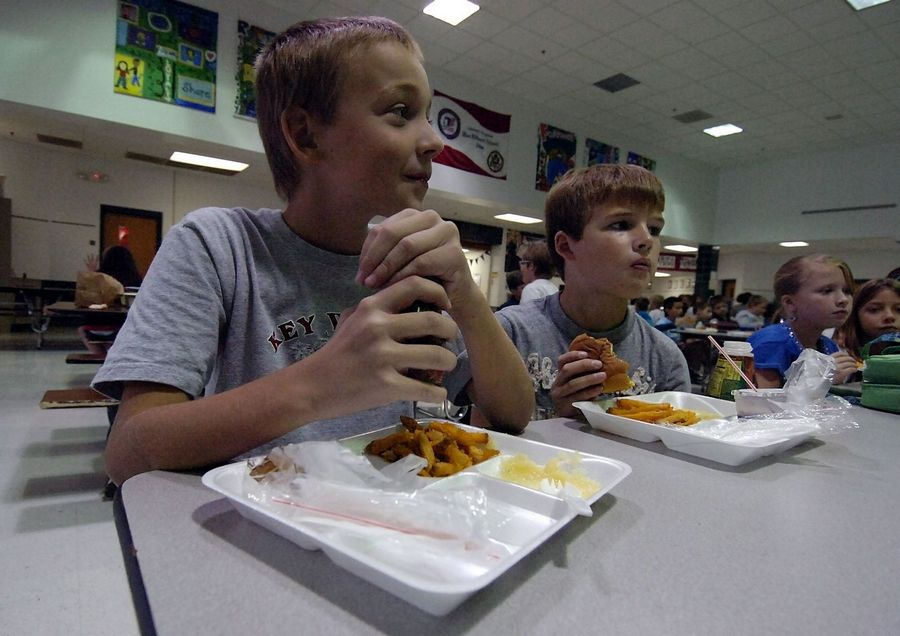 Jeffrey Hilbert,10, and Colin Priller,10, both of Arlington Heights, eat lunch off their Styrofoam plates during second period lunch at Westgate School, which recycles the plates for later use.